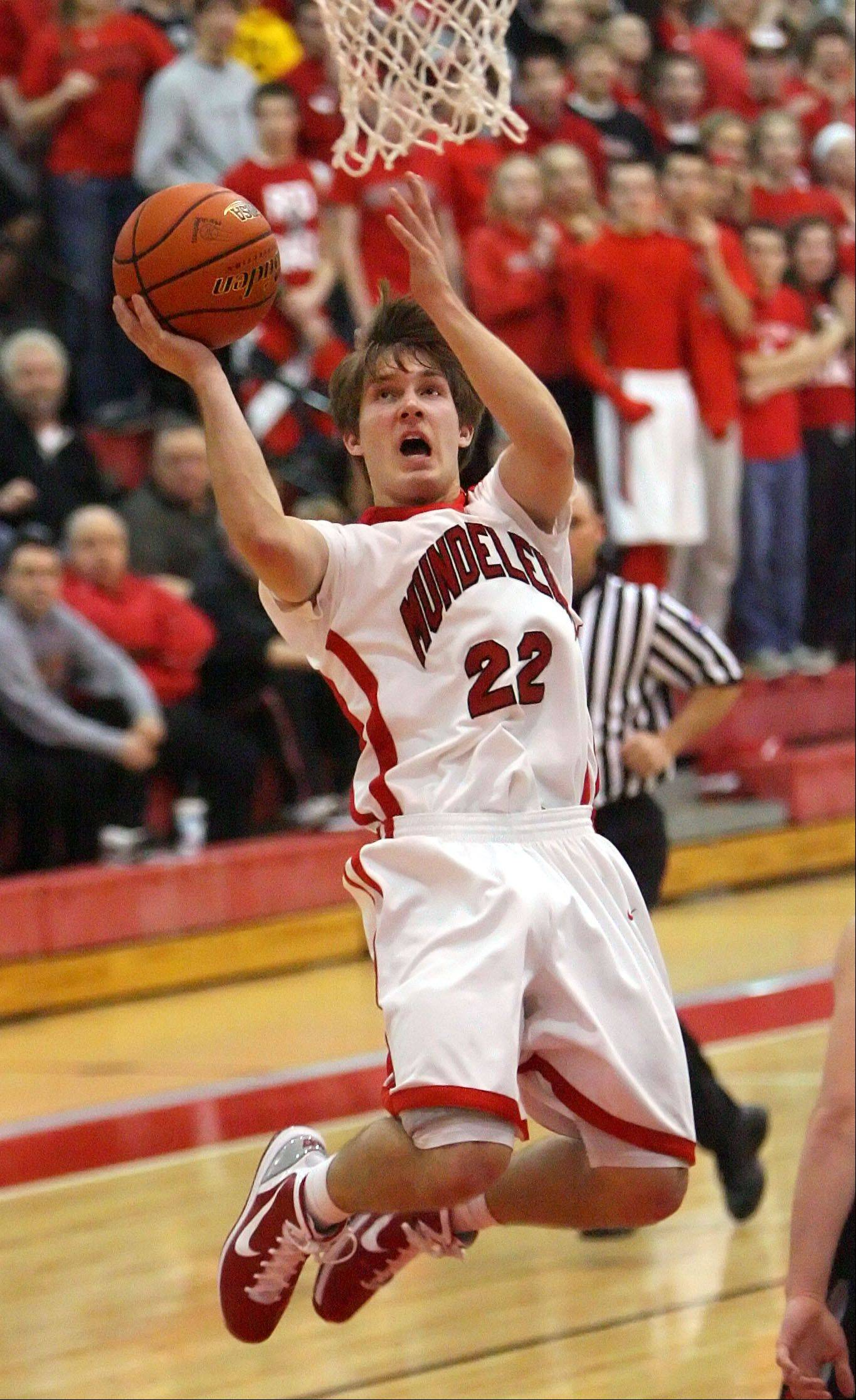Mundelein's Robert Knar, here driving to hoop against Deerfield in sectional play at Barrington, has suffered a torn left ACL and is facing surgery. He'll likely miss most of his senior high school season.