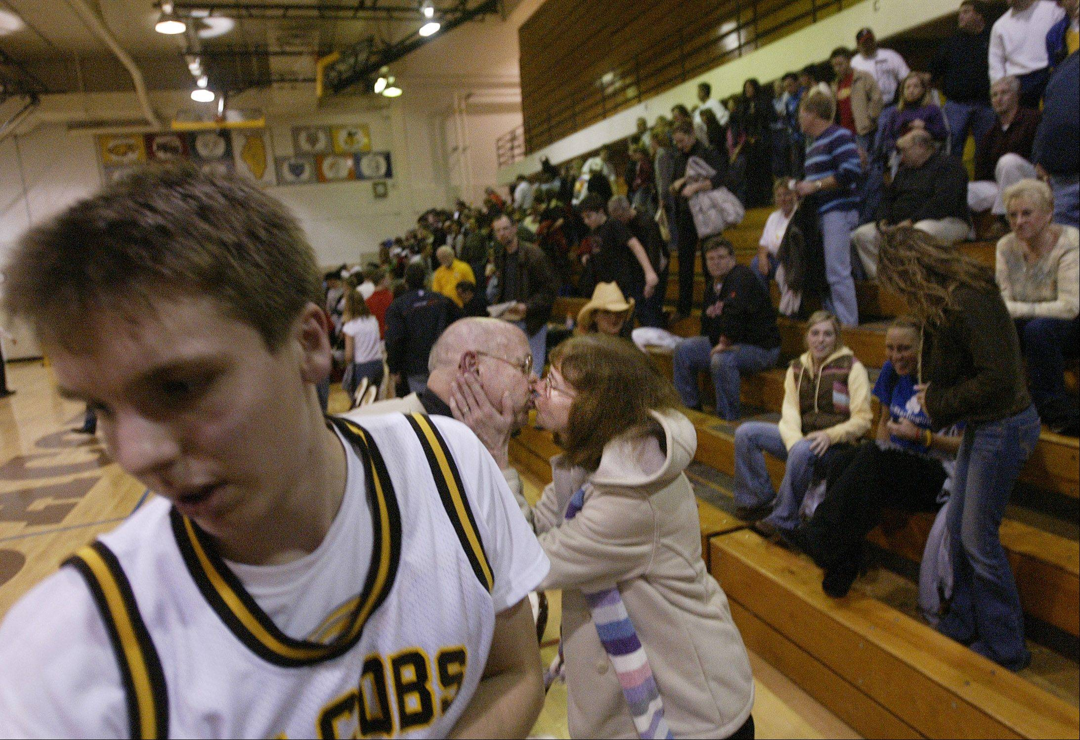 Jim Hinkle receives a celebratory kiss from his wife Barbara after the Golden Eagles beat Huntley for Hinkle's 400th career coaching victory.