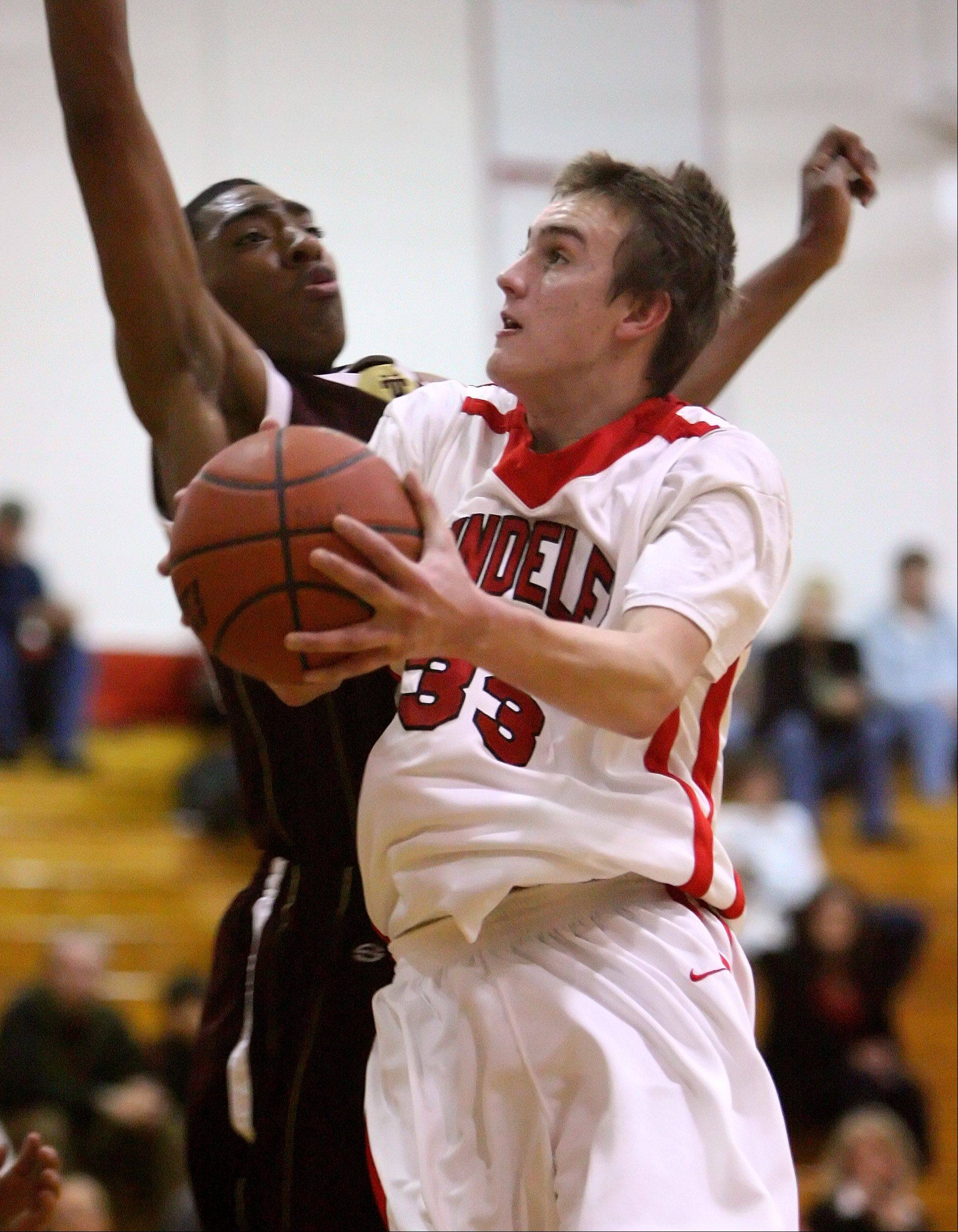 Mundelein's Sean O'Brien drives on Uplift's Corey Gonore during nonconference play last season at Mundelein. O'Brien has announched he'll play for Southern Illinois next school year.