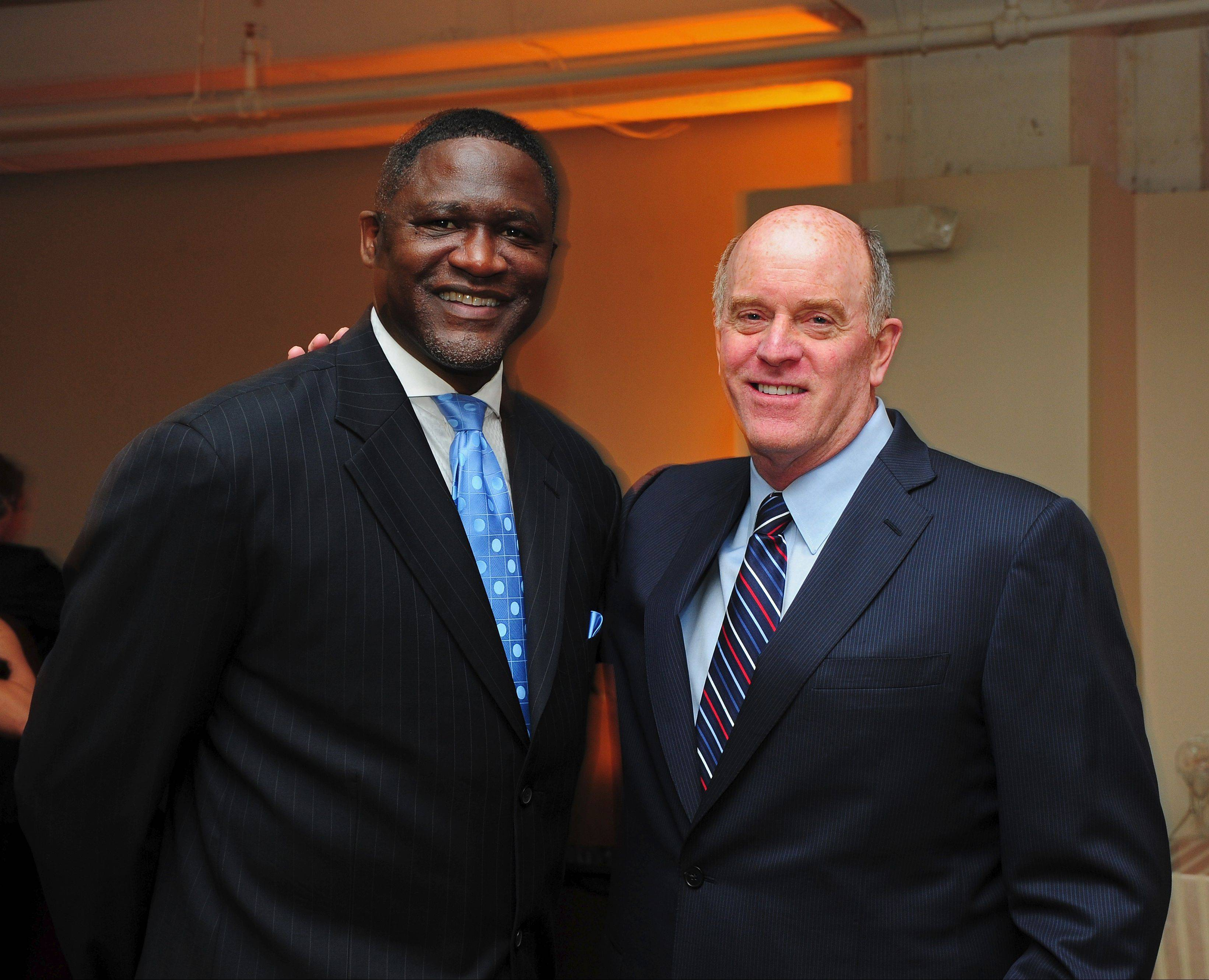 Elgin native and 1969 Elgin High School graduate Rick Sund, right, poses with NBA Hall of Fame member Dominique Wilkins last year. Sund, who has been an NBA executive for 40 years, will be honored with a special recognition award by the Elgin Sports Hall of Fame Foundation Sunday night at the organization's annual banquet and induction ceremony in the Heritage Ballroom at The Centre of Elgin.