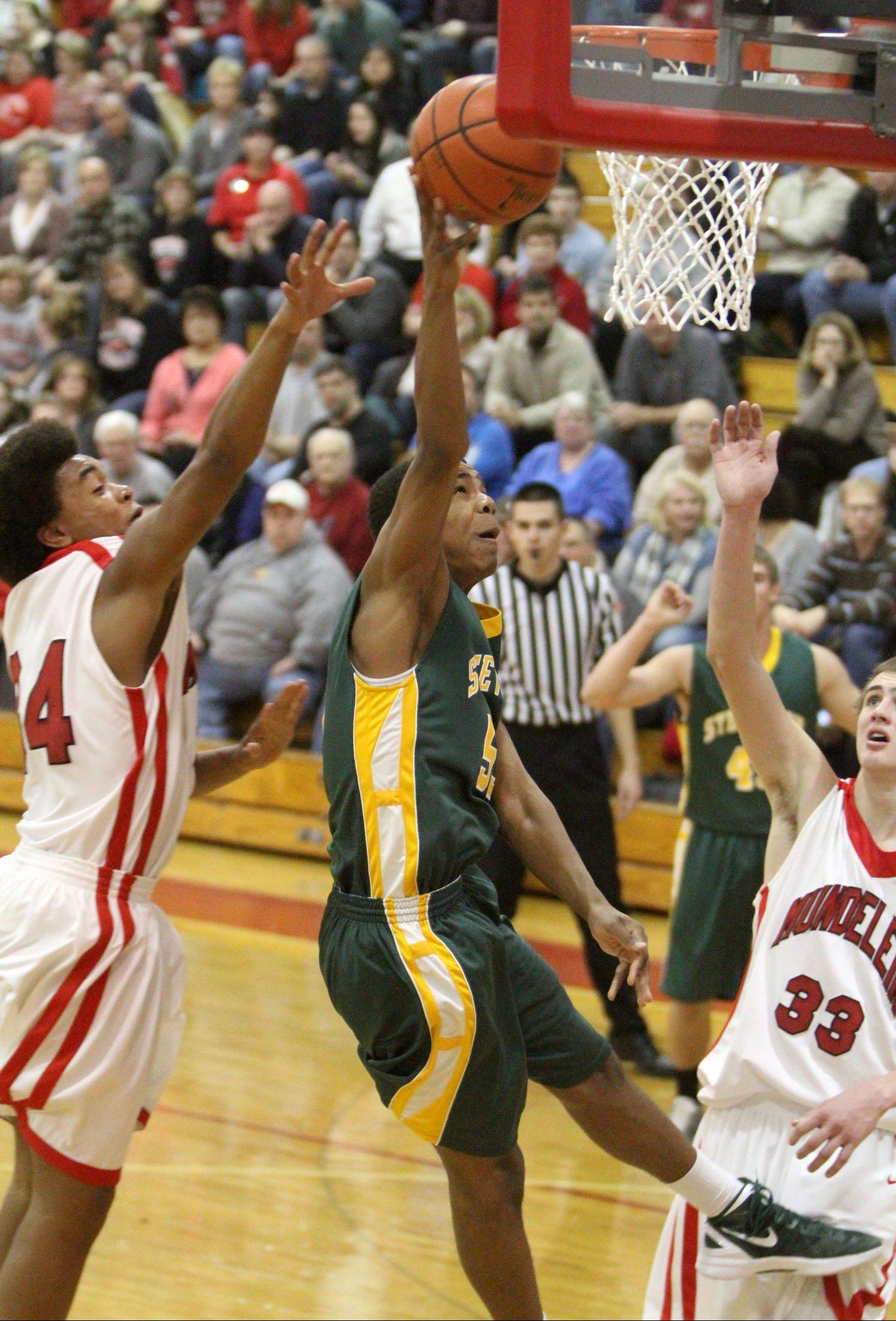 Mundelein's Cliff Dunigan, left, shown here defending a shot by Stevenson's Connor Cashaw last season, will play next season at Missouri Science and Technology.