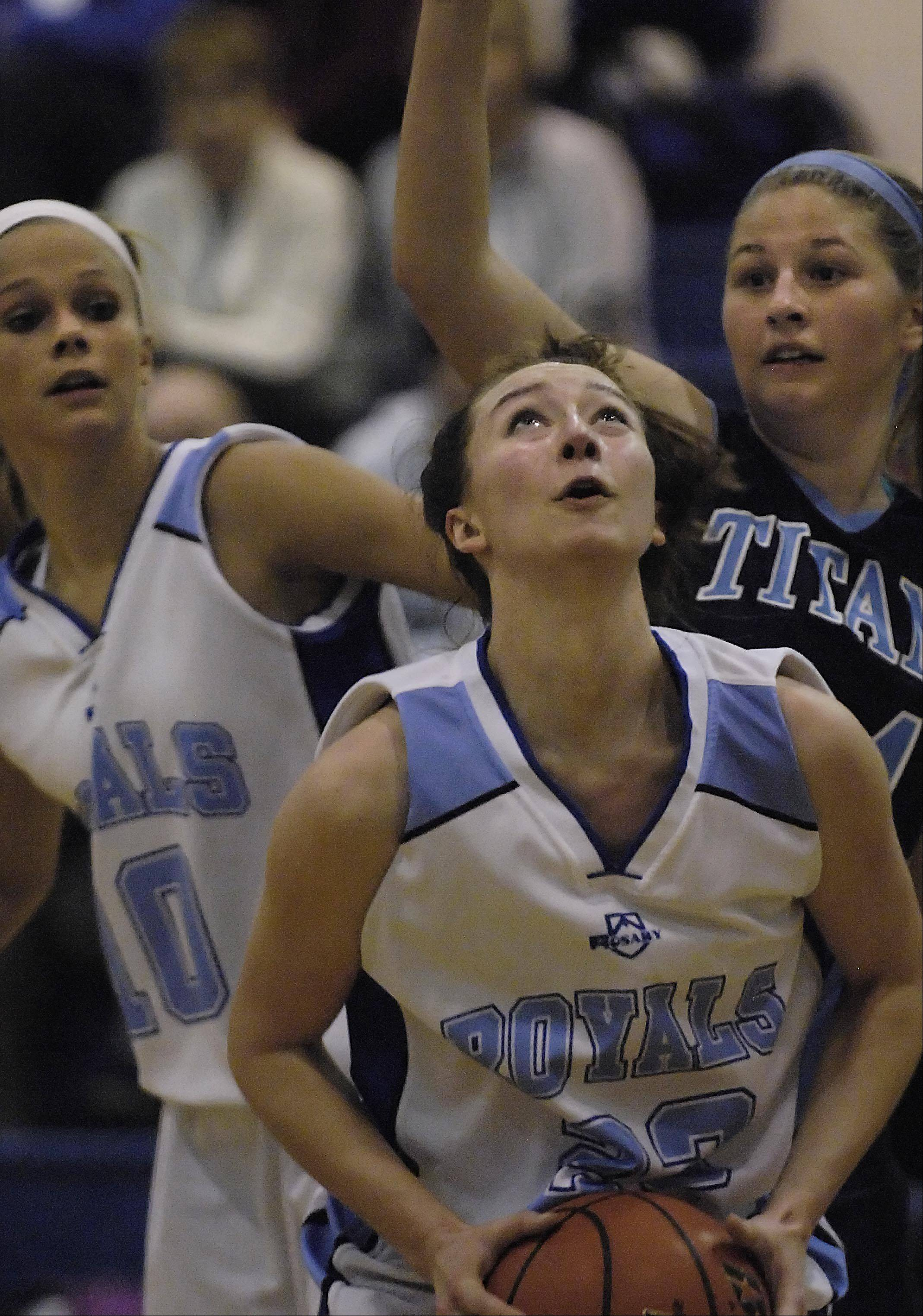 Rosary's Mary Wentworth looks for the hoop as teammate Quincy Kellett blocks out IMSA's Rae Hohle Monday in Aurora.
