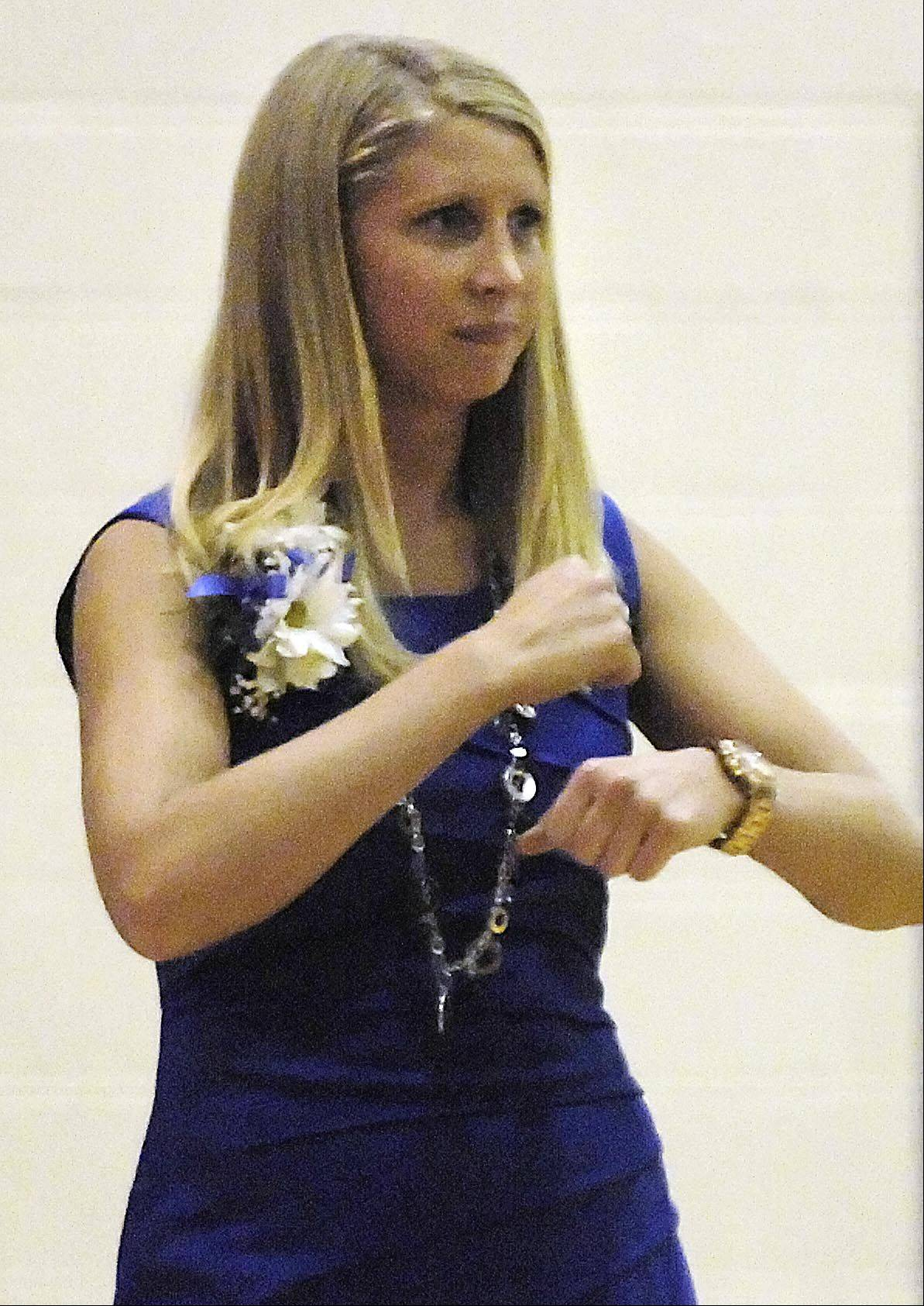 Rosary's new head coach Jessie Wilcox signals traveling against IMSA Monday in her first game in Aurora.