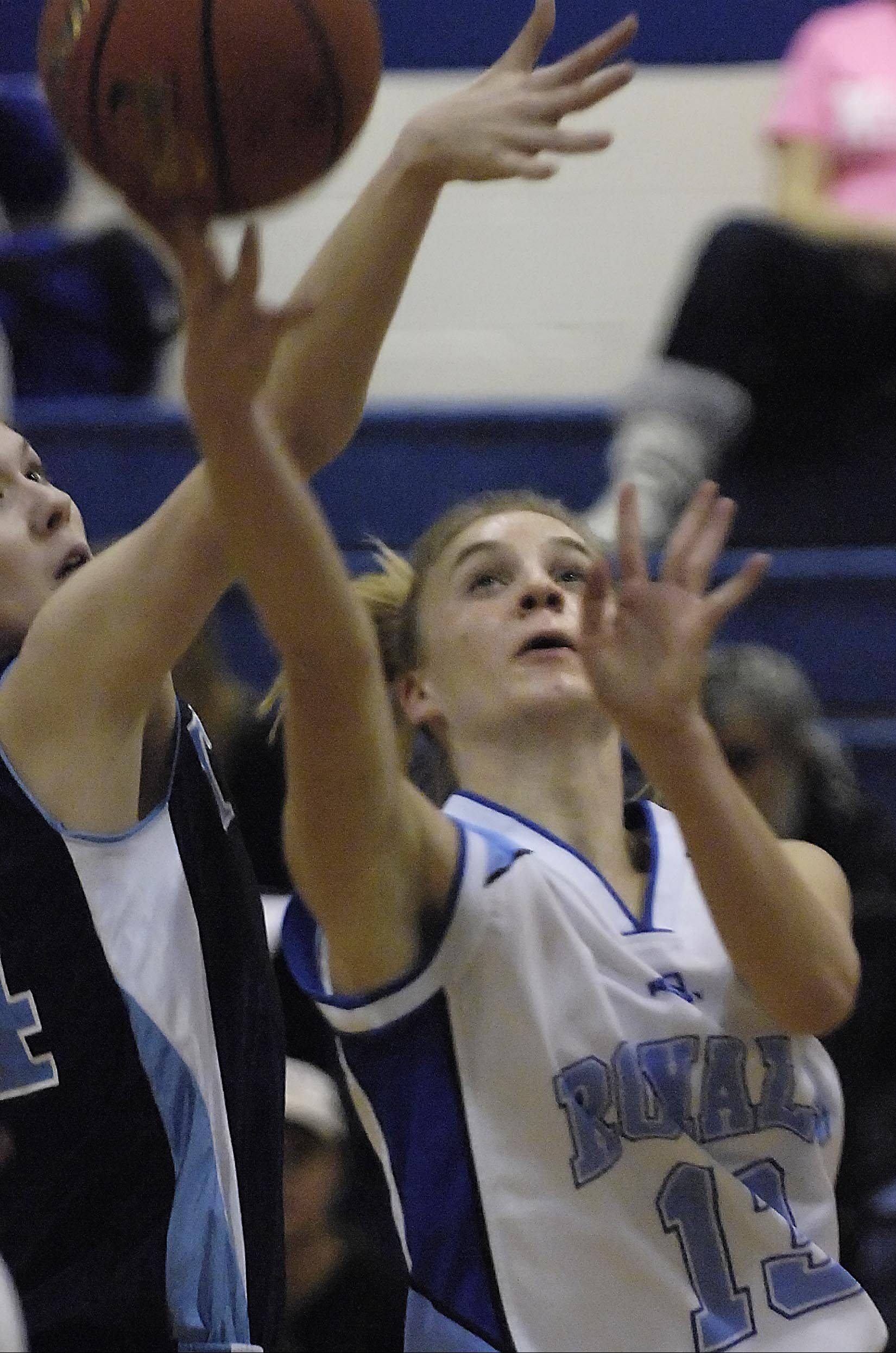 Rosary's Karly Tate scores on a layup under the defense of IMSA's Lindsey Conley Monday in Aurora.