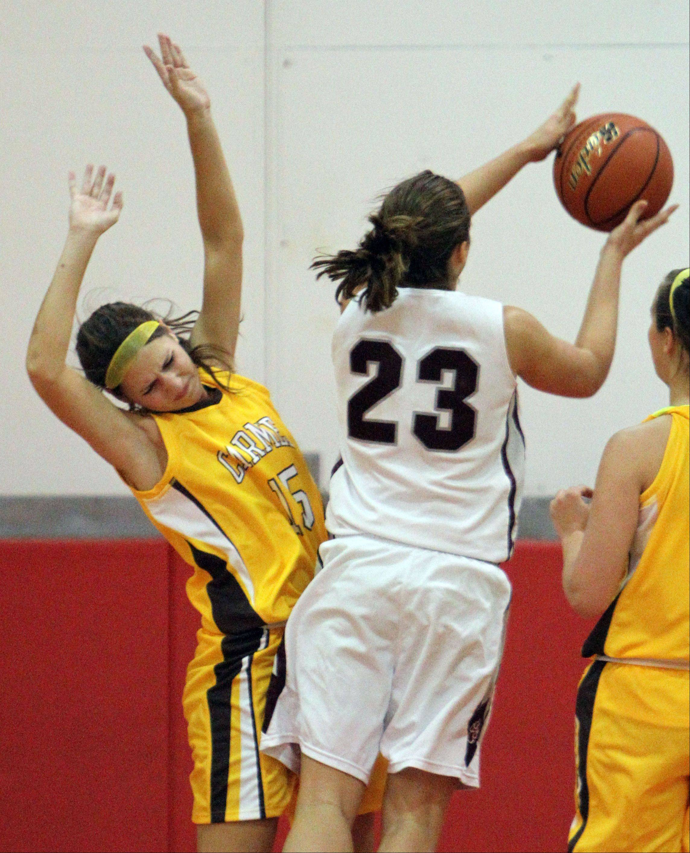 Prairie Ridge's Alex Neckopoulos, right, drives on Carmel's Paige Gauthier at the Mundelein Turkey Tournament on Monday.