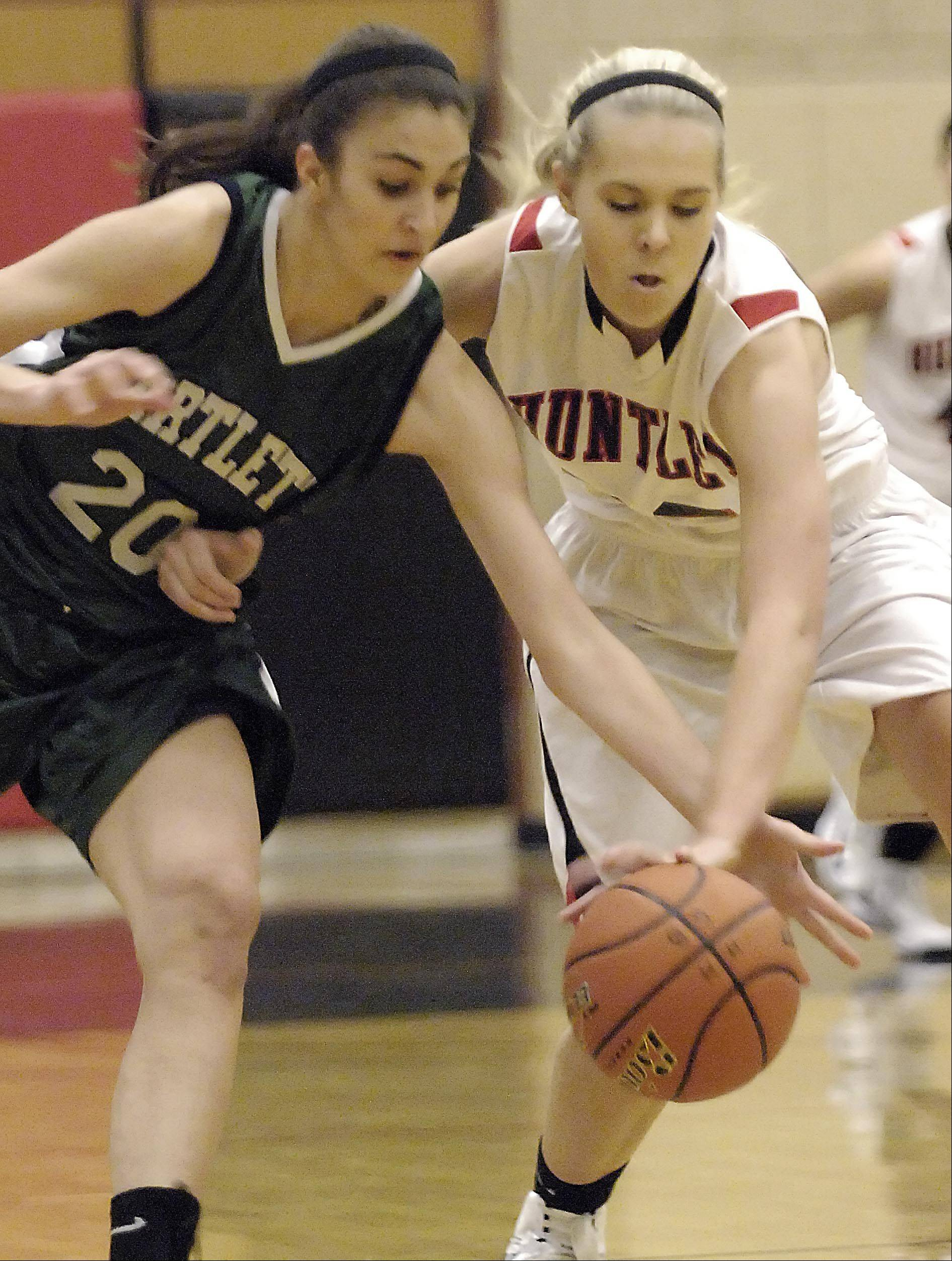 Huntley's Ali Andrews steps in front of a pass to Bartlett's Elizabeth Arco Tuesday in Huntley.