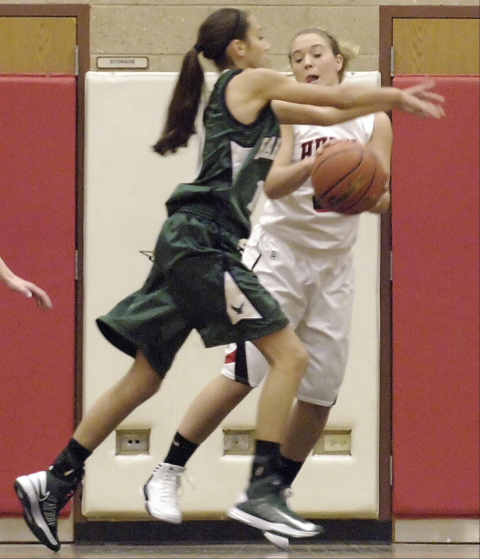 Huntley's Jessica Brock steals a pass intended for Bartlett's Elizabeth Arco Tuesday in Huntley.