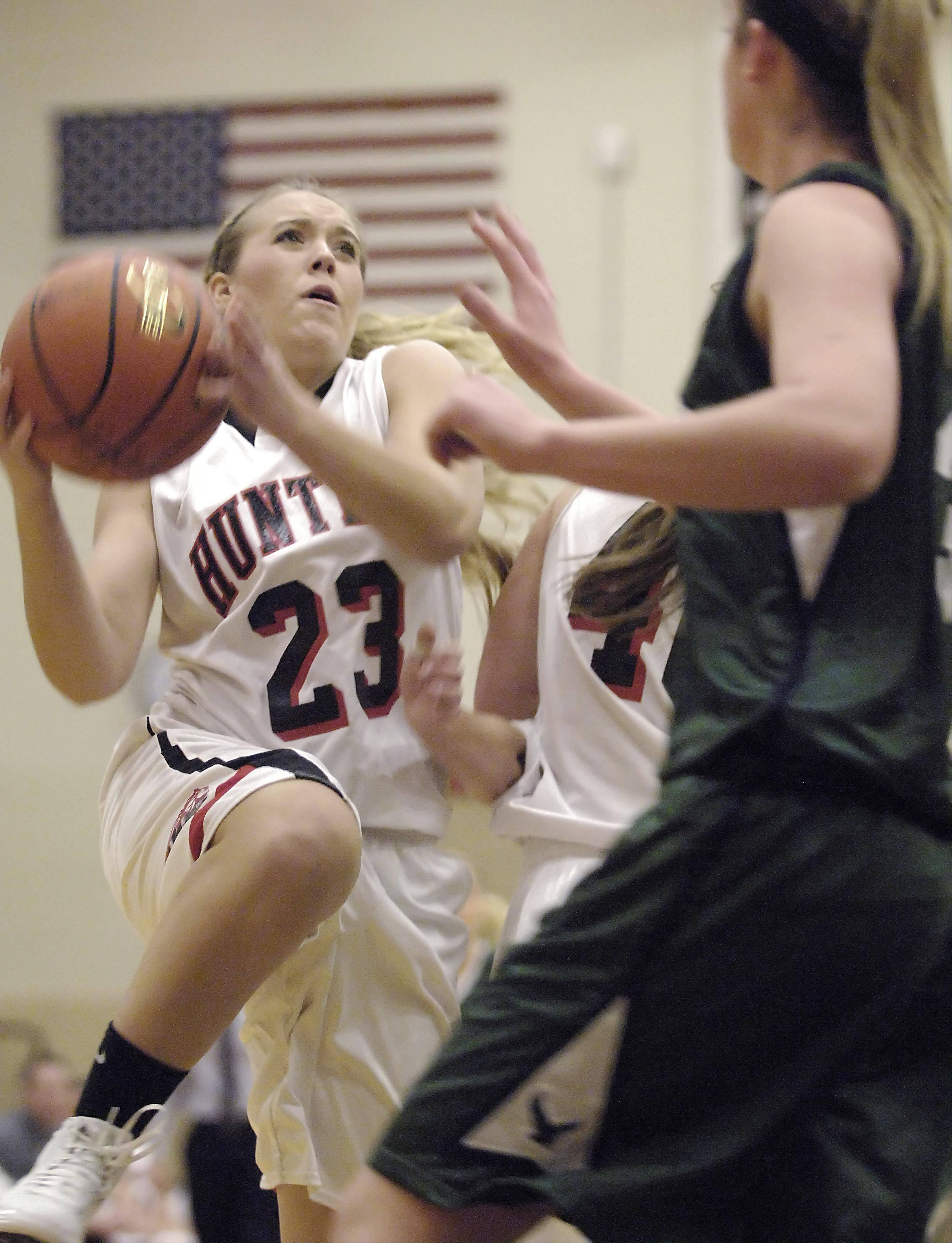 Huntley's Jessica Brock drives to the basket against Bartlett's Brooke Kulbeda Tuesday in Huntley.