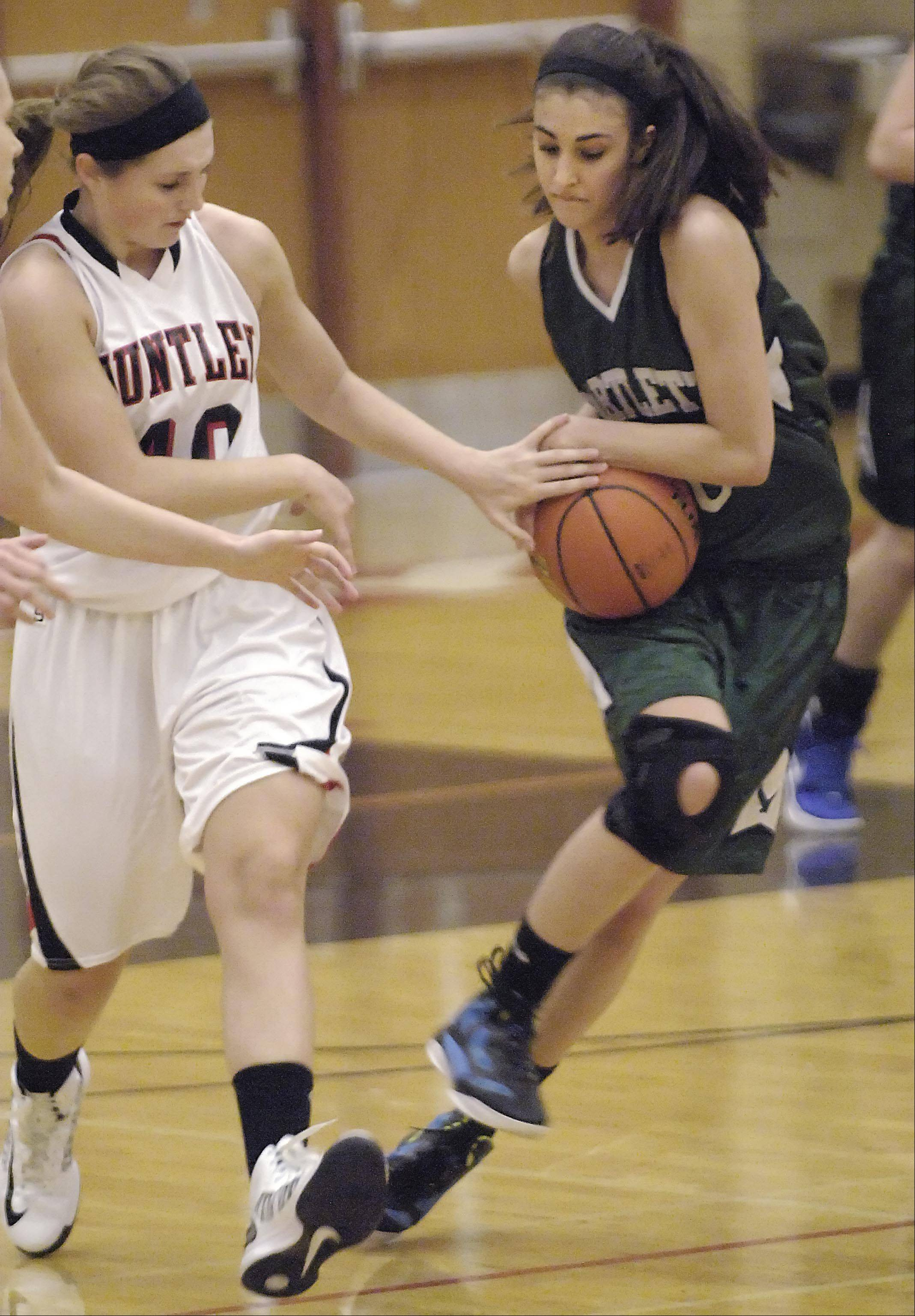 Bartlett's Elizabeth Arco takes the ball from Huntley's Sam Andrews Tuesday in Huntley.