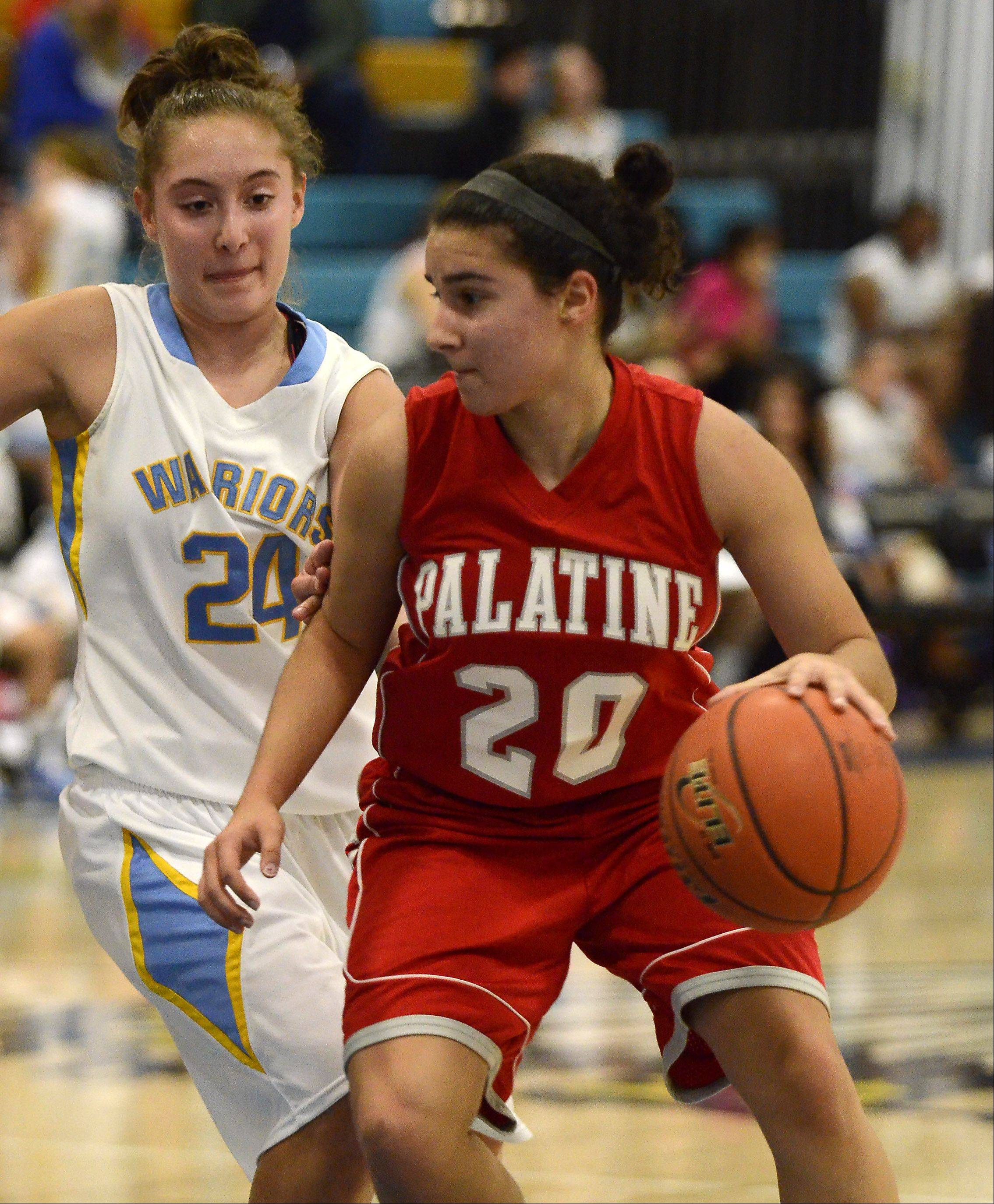 Palatine's Nia Pappas (20) works to get inside against Maine West's Alexia Prosperi (24) Monday night in Des Plaines. Pappas later hit the game-winning shot for the Pirates.