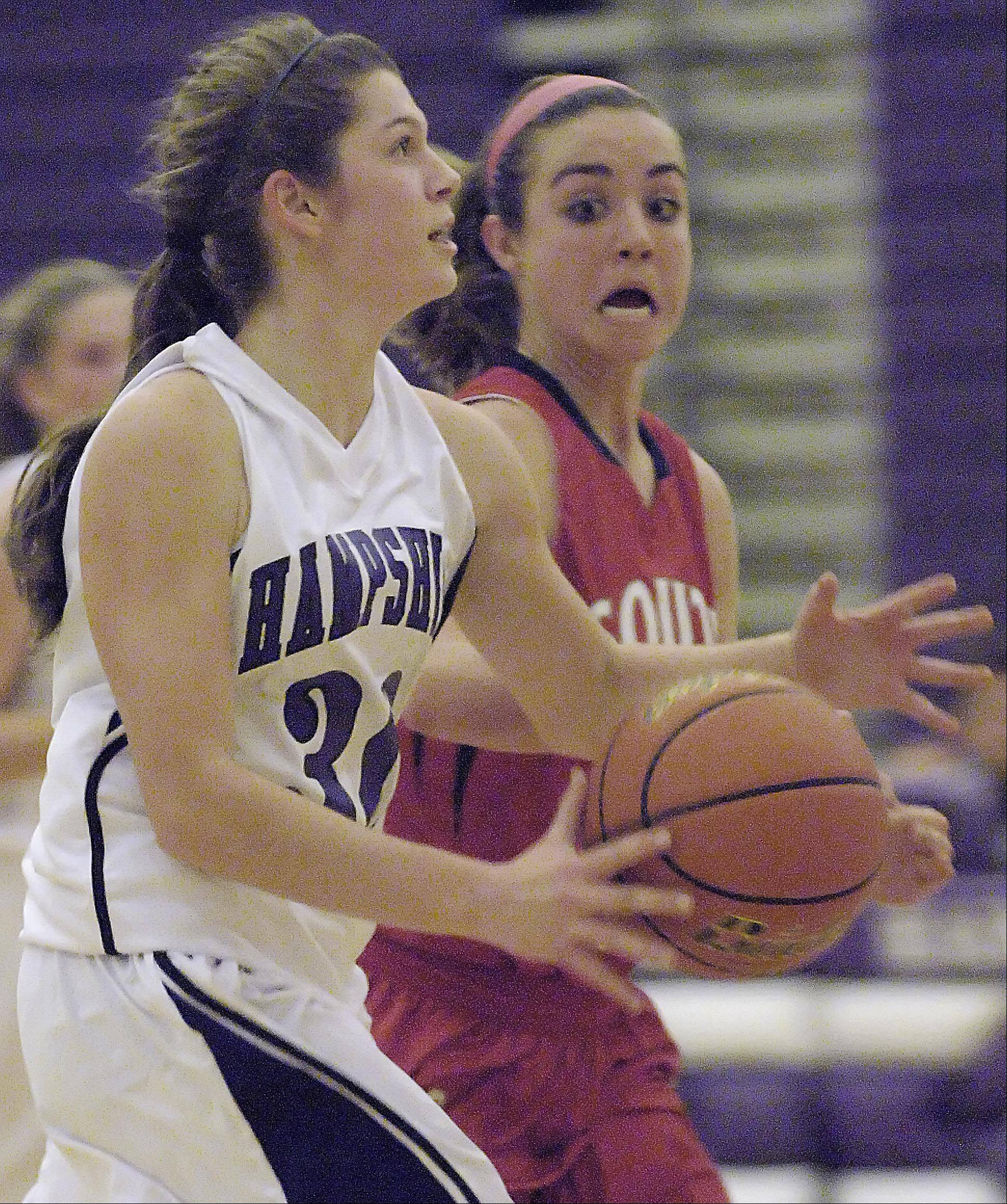 South Elgin's Delaney Kelleher keeps an eye of the ball as Hampshire's Jen Dumoulin drives to the basket Wednesday in Hampshire.