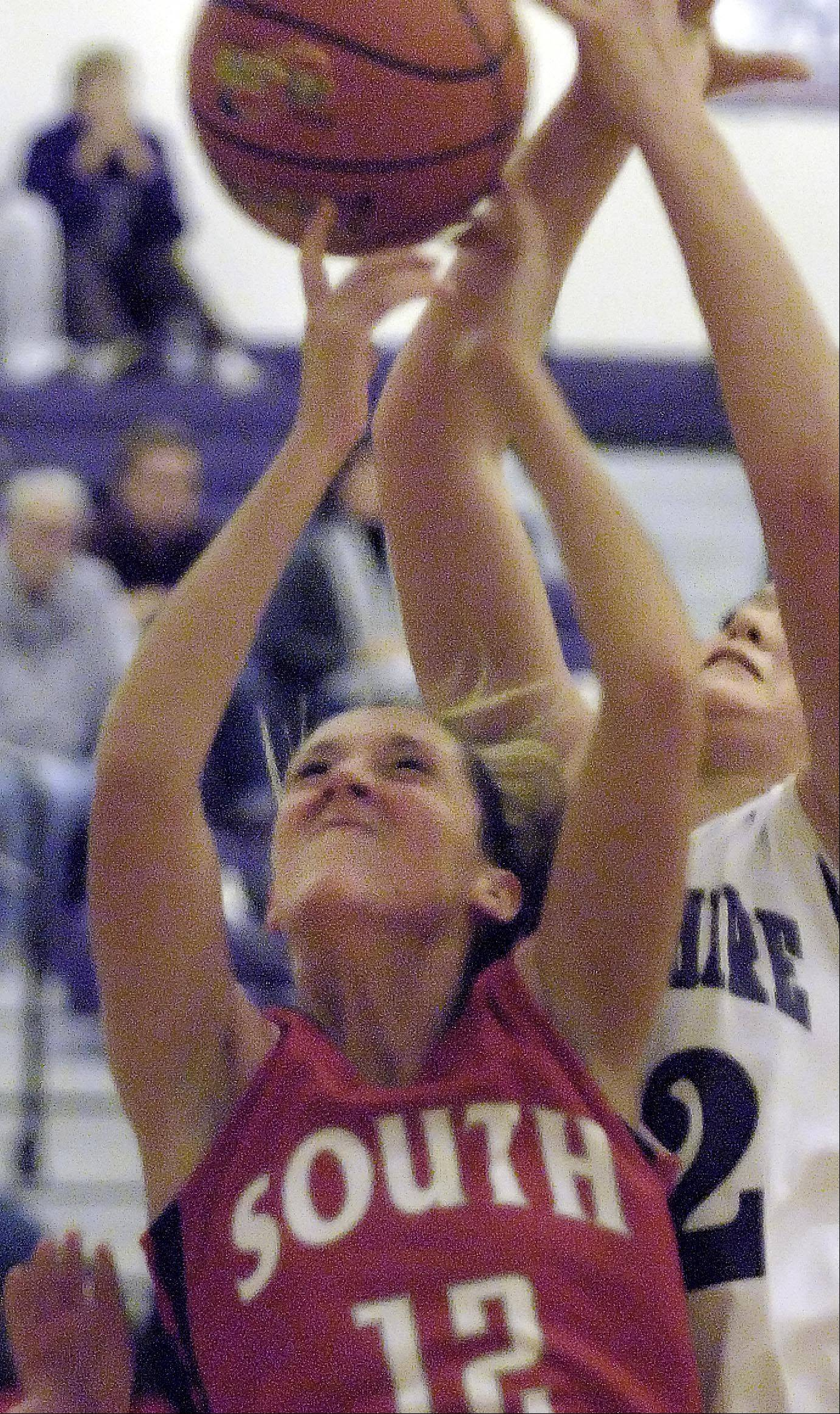South Elgin's Nell Wentling and Hampshire's Emma Benoit fight for a rebound Wednesday in Hampshire.