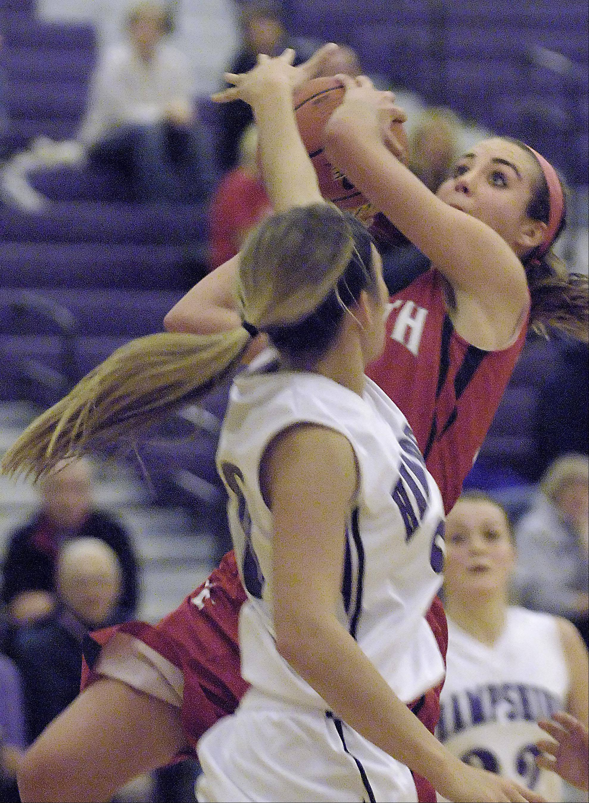 South Elgin's Delaney Kelleher drives on Hampshire's Lizzy Panzica Wednesday in Hampshire.