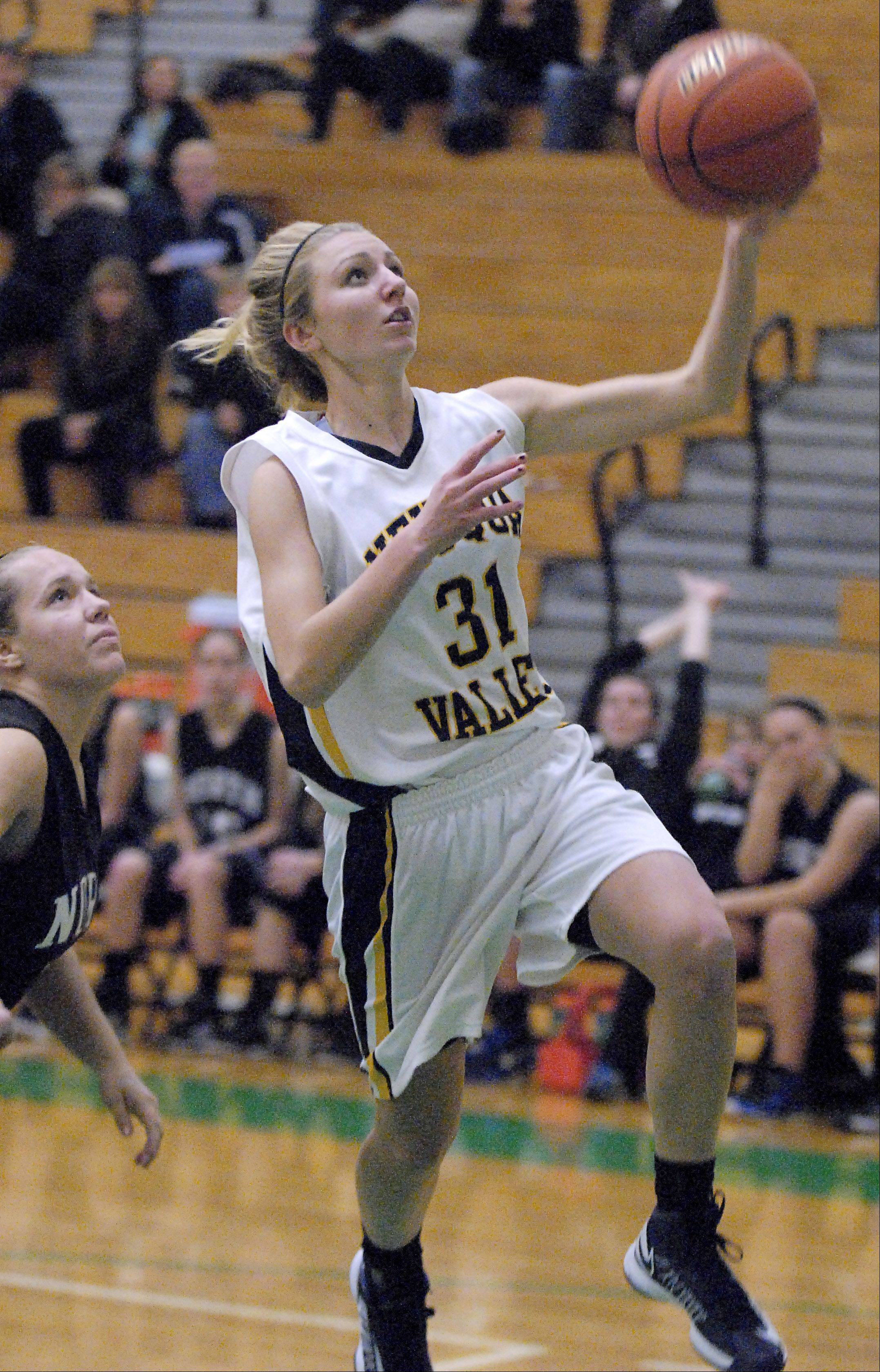 Nequa Valley's Megan Kalkofen sinks a shot in the second quarter on Wednesday, November 14.