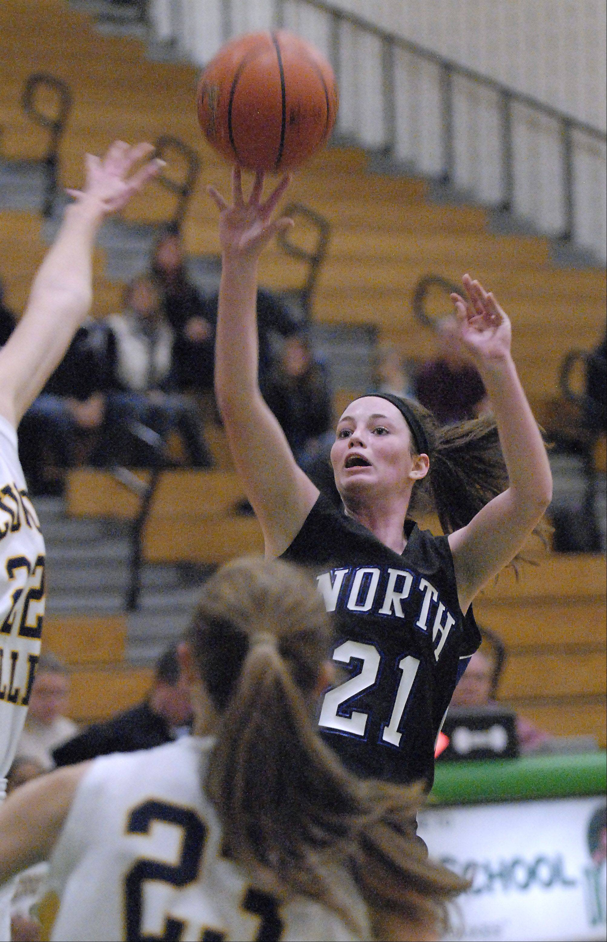St. Charles North's Alex Silverman shoots over Nequa Valley in the first quarter on Wednesday, November 14.