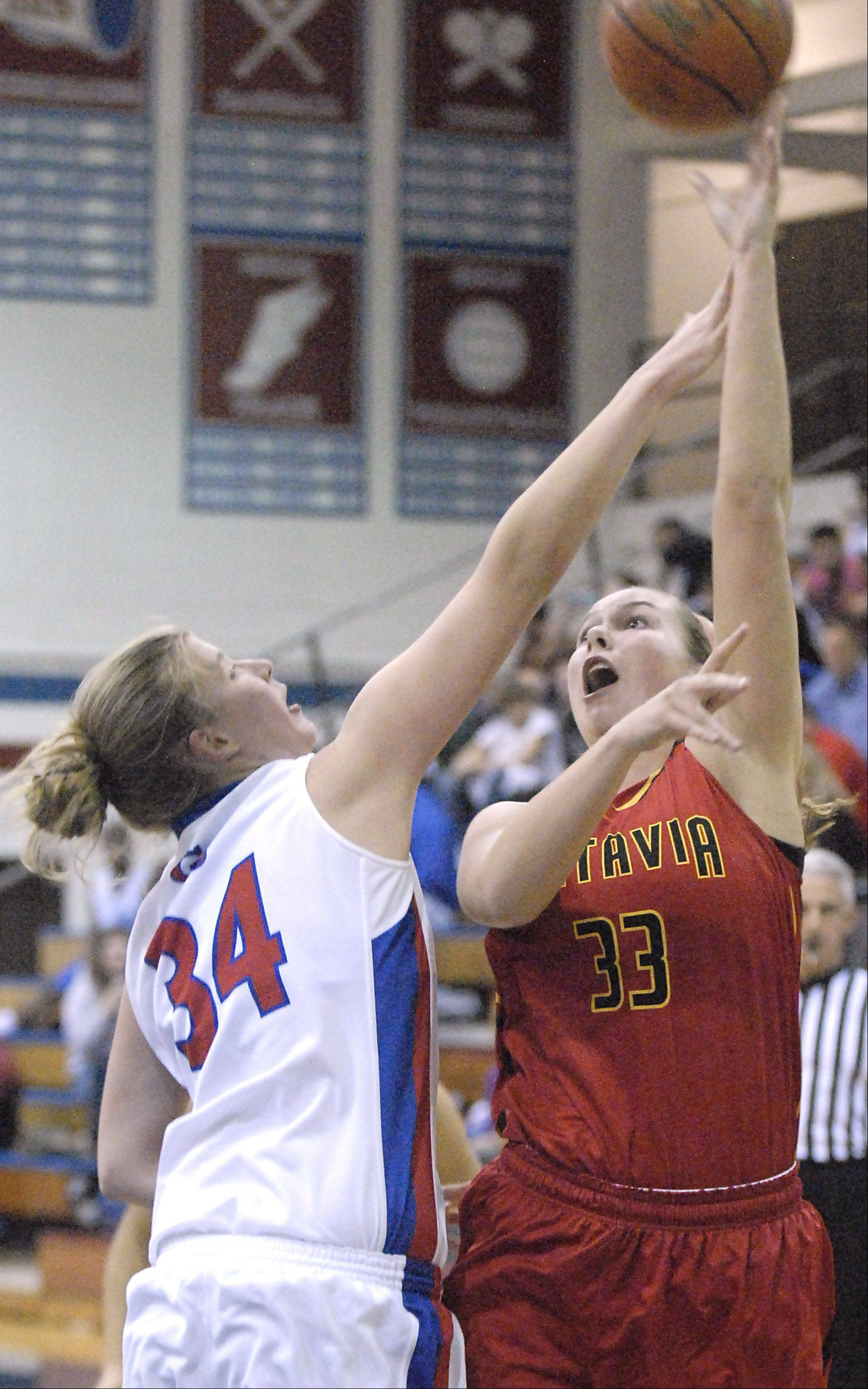 Glenbard South's Sydney Bauman attempts to block a shot by Batavia's Erin Bayram in the first quarter on Tuesday, November 13.