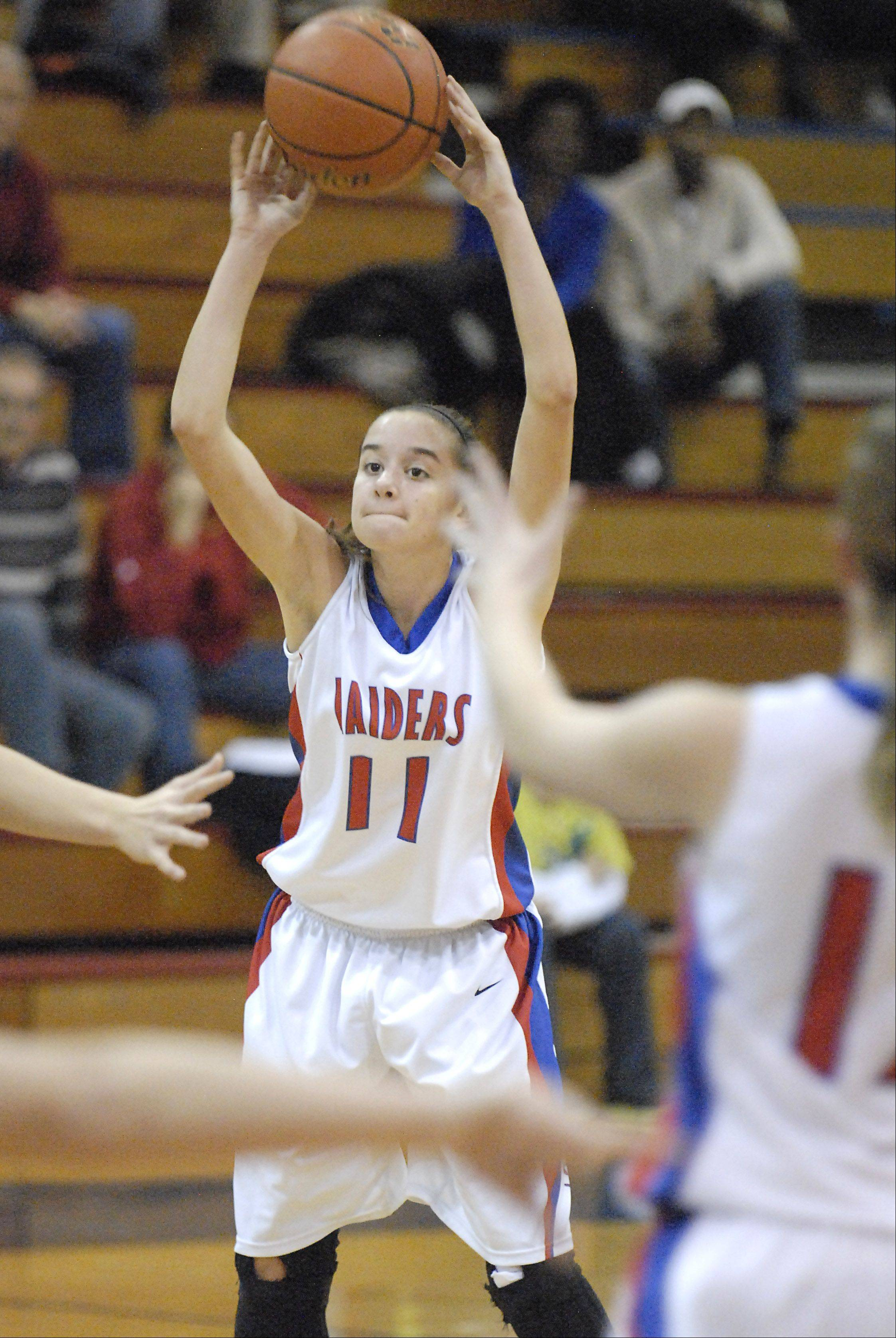 Glenbard South's Jenna Brambora looks to pass in the second quarter on Tuesday, November 13.