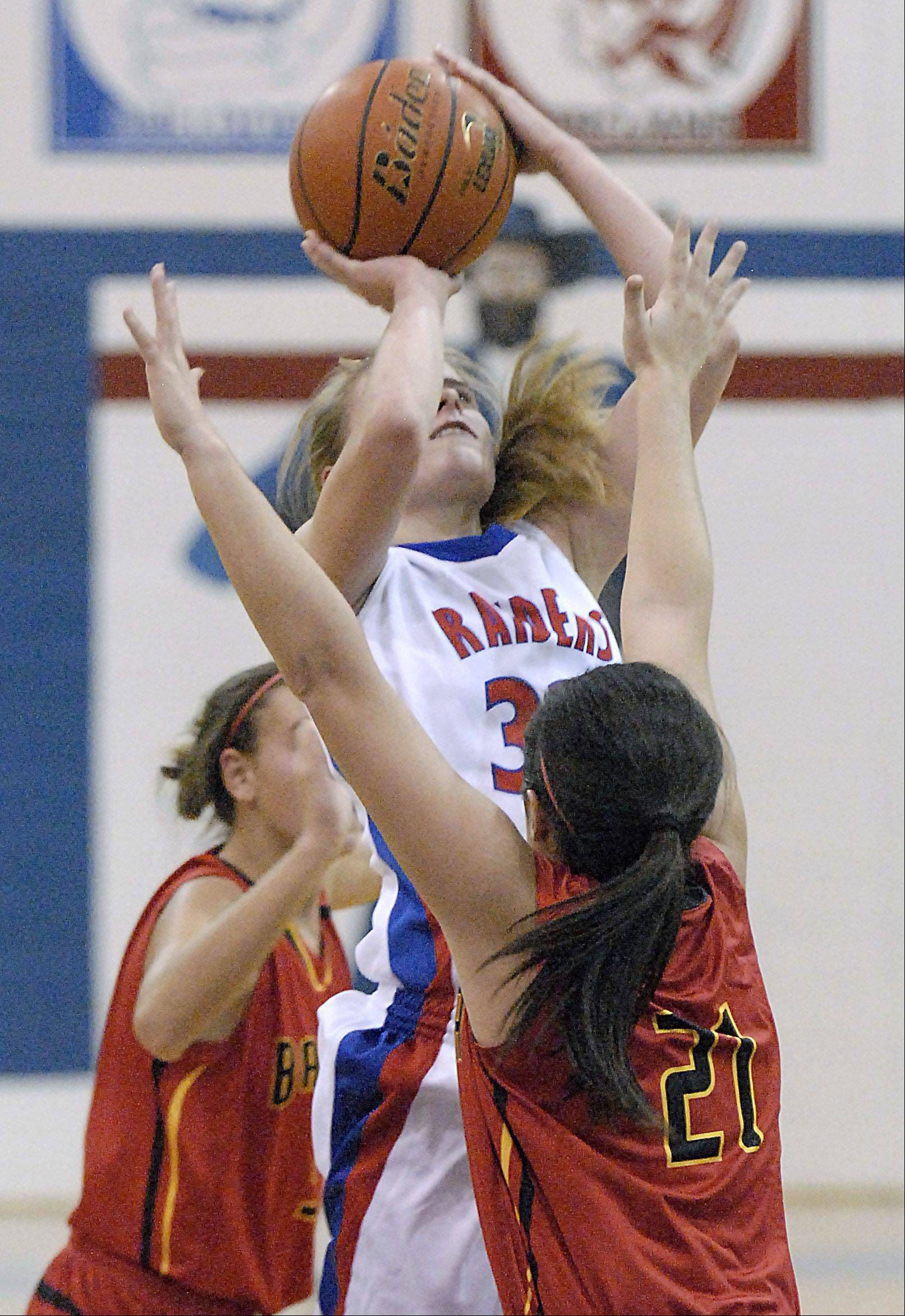 Glenbard South's Tomei Ball shoots over Batavia's Sami Villarreal in the second quarter on Tuesday, November 13.