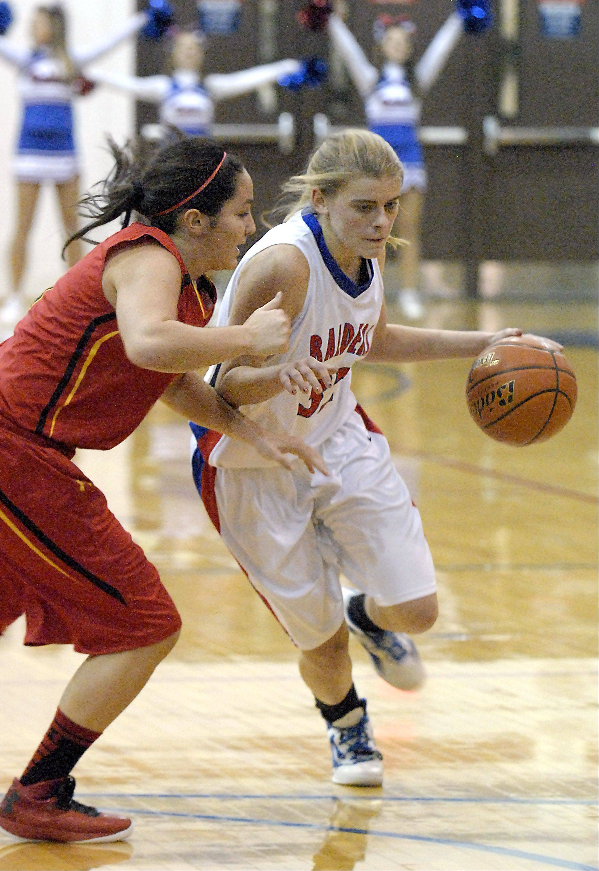 Glenbard South's Tomei Ball dribbles around Batavia's Sami Villarreal in the third quarter on Tuesday, November 13.