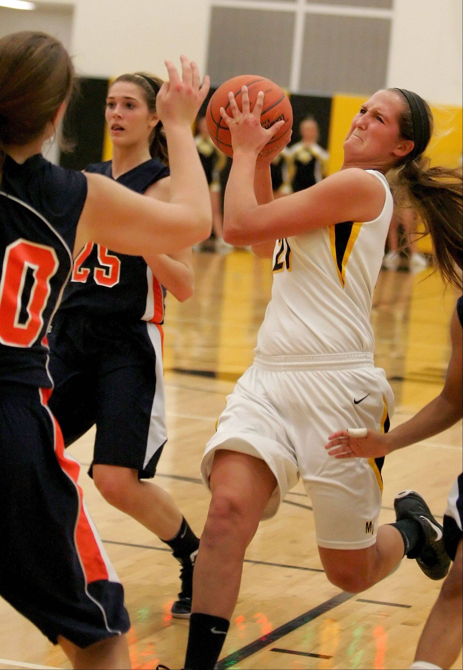 Anna Petersen of Metea Valley drives to the basket in girls basketball action against Naperville North on Tuesday in Aurora.