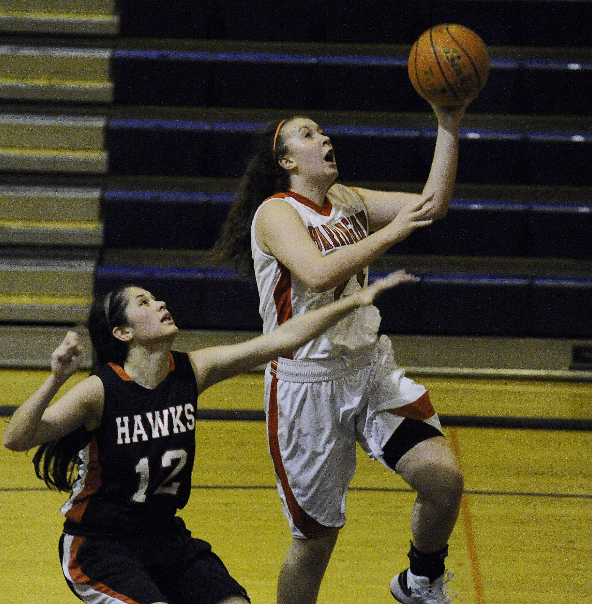 Maine South's Mackenzie Duffy is unable to stop the drive to the basket by Aoife Callanan of Barrington during the Bison Classic girls varsity basketball Thanksgiving Tournament at Buffalo Grove High School on Thursday.