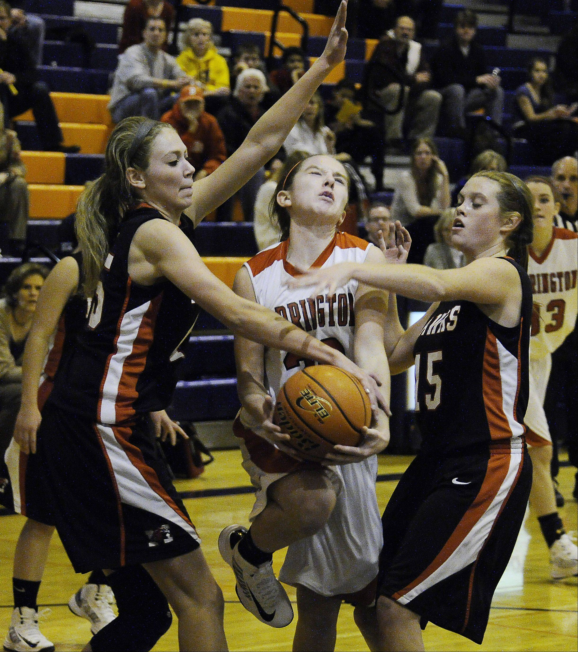 Maine South's Hailey Schoneman fouls Barrington's Kelly Katis as she drives to the basket in the second half of the Bison Classic girls varsity basketball Thanksgiving Tournament at Buffalo Grove High School on Thursday.