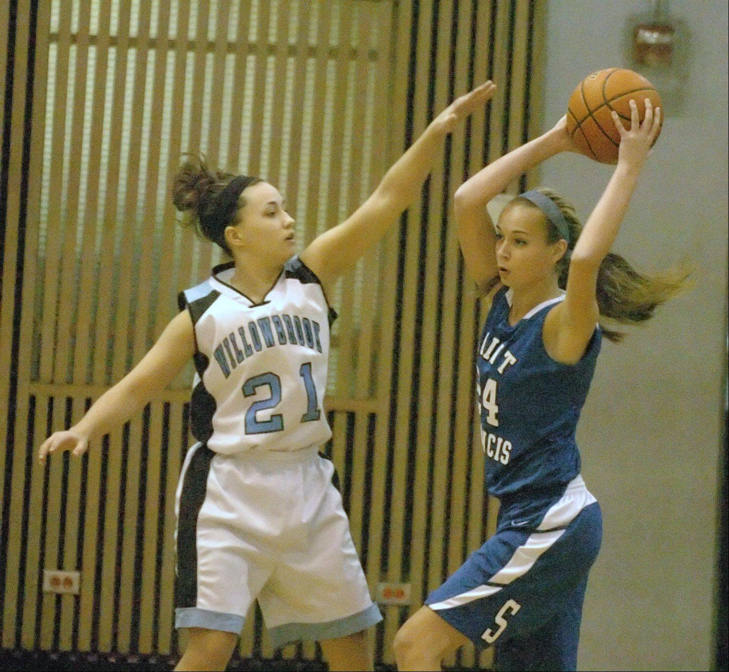 Abby Pakeltis,left, of Willowbrook tries to stop Hanna Malak of St. Francis. This took place during the St. Francis at Willowbrook 19th annual Willowbrook Warriors Thanksgiving Invite Thursday.