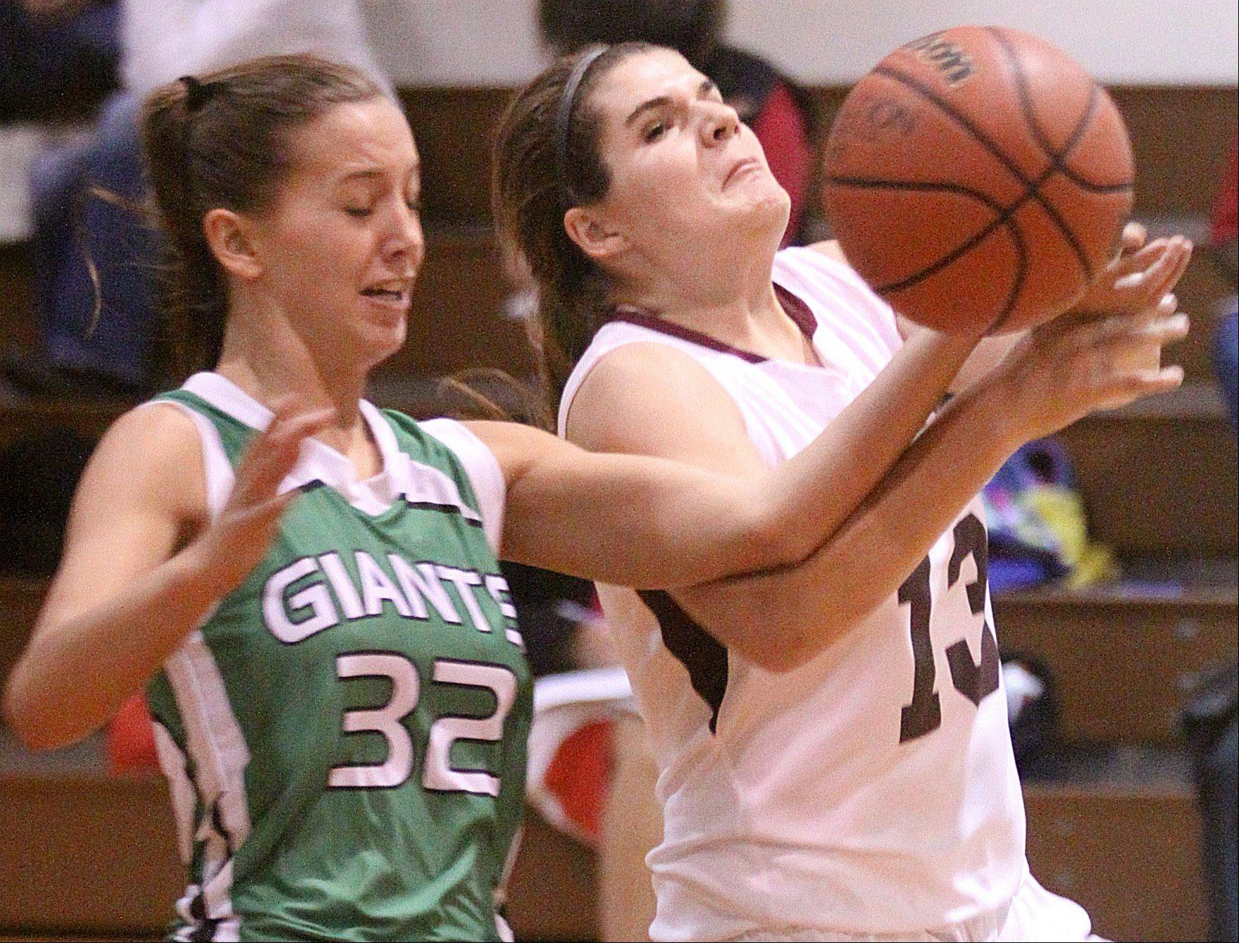 Elgin's Anna Eckholm, right, gets tangled up with Alden-Hebron's Brooklyn Hilton, left, during a Thanksgiving Basketball Tournament game at Elgin Academy on Thursday night.