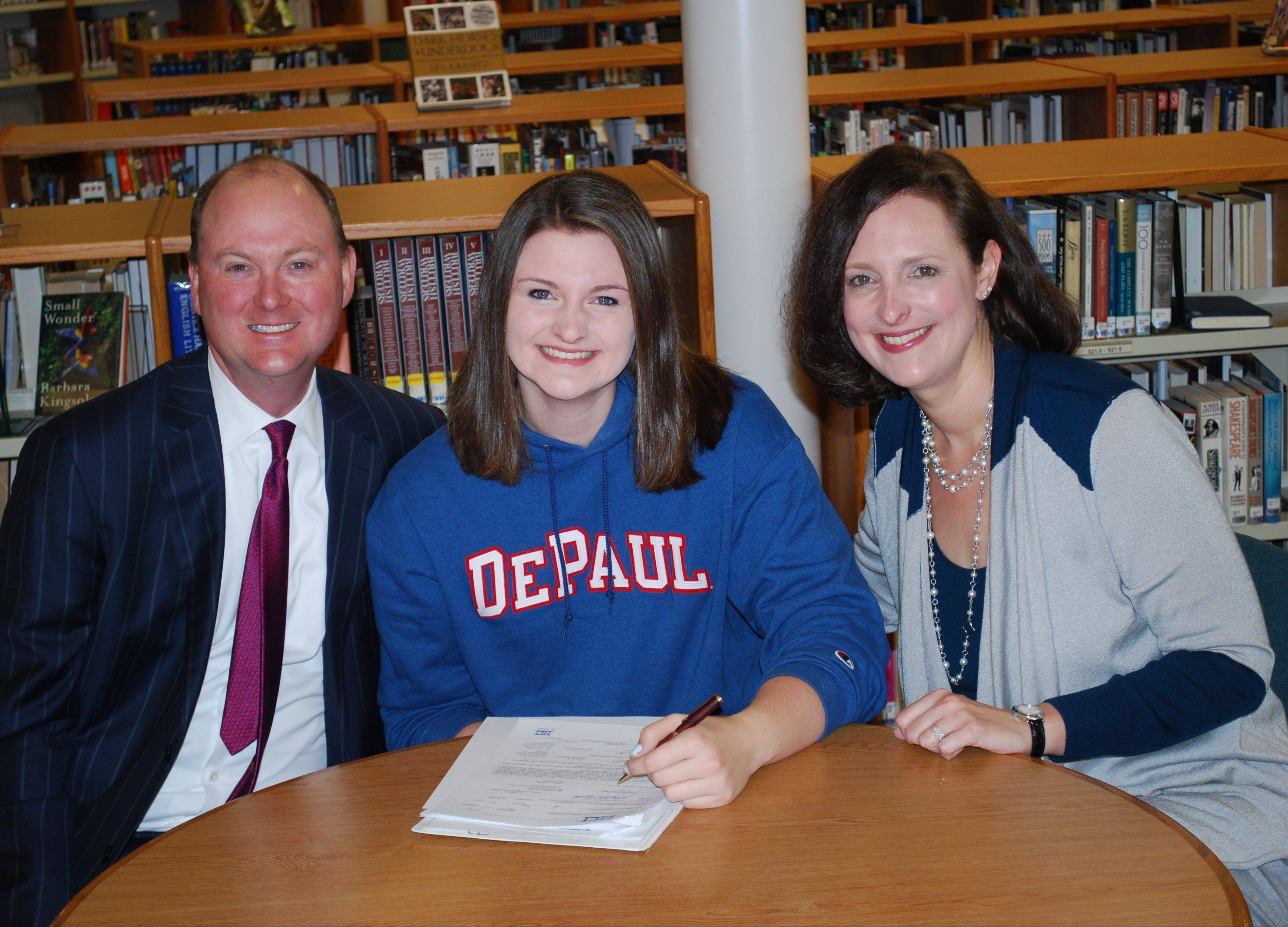 Vernon Hills senior Meri Bennett-Swanson poses with her parents, Shane Swanson and Susan Bennett, after signing her national letter of intent with DePaul University on Wednesday.