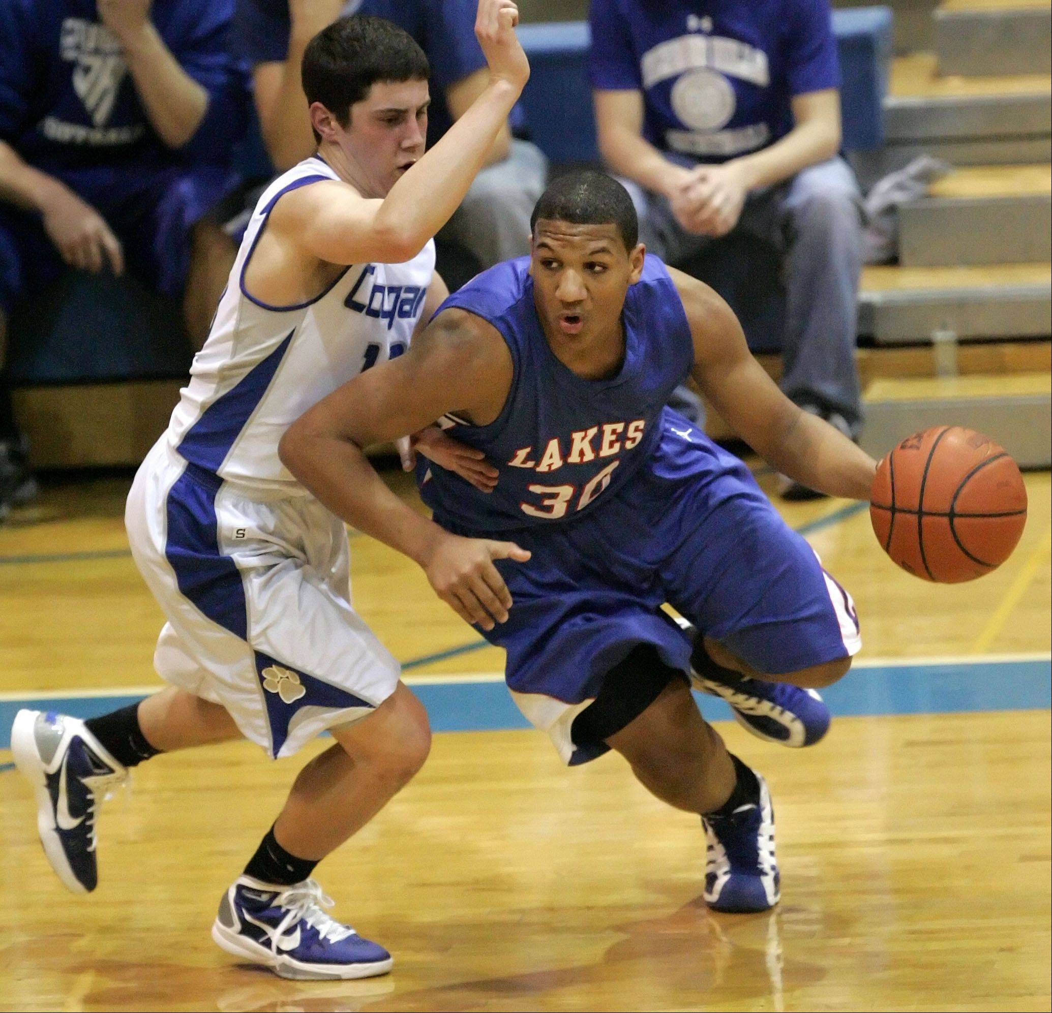 Lakes' Direll Clark, right, drives on Vernon Hills' Chris Argianas at Vernon Hills.