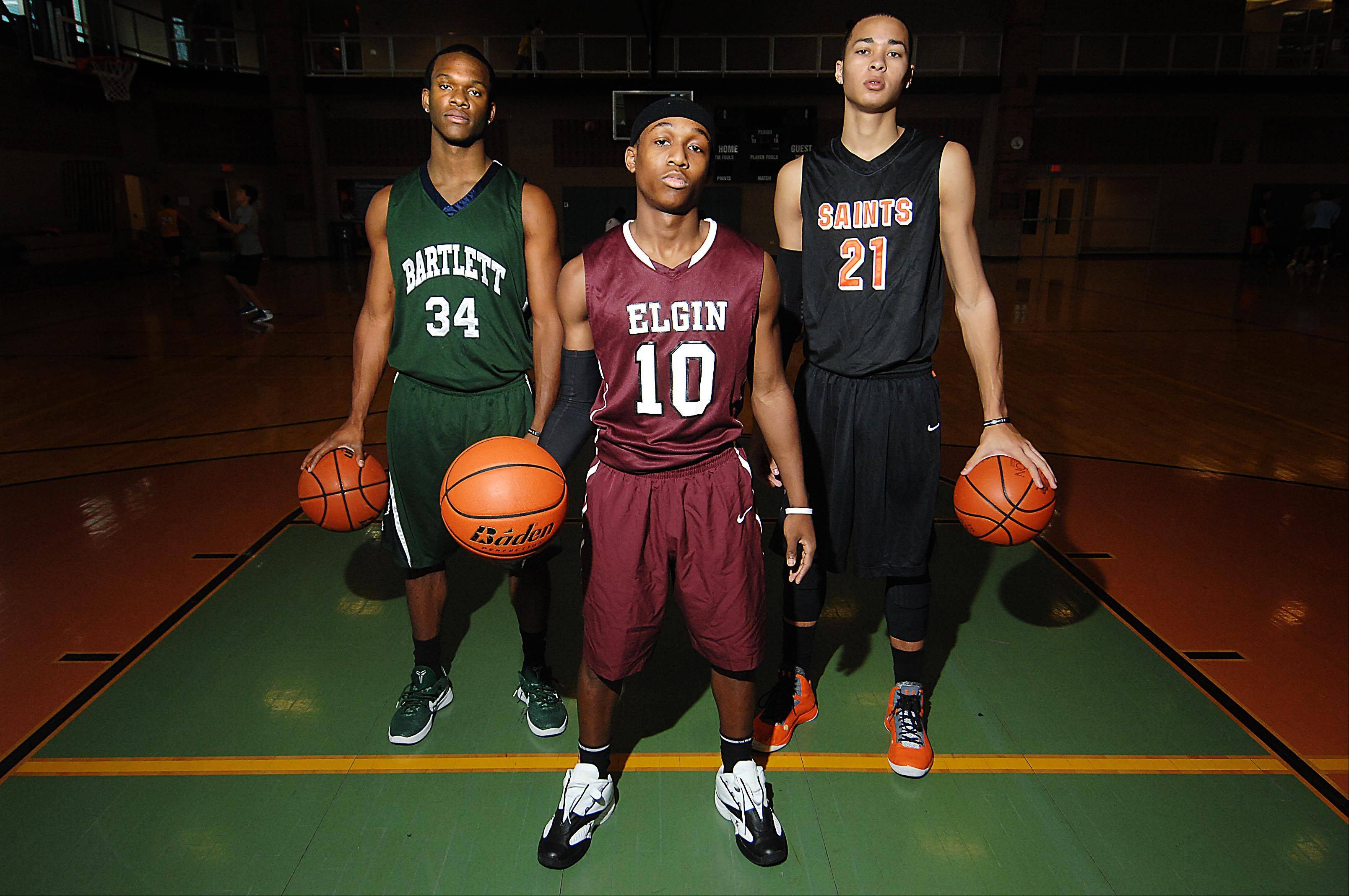 Lance Whitaker of Bartlett High School, Arie Williams of Elgin High School, and Kendall Stephens of St. Charles East High School, are AAU teammates.
