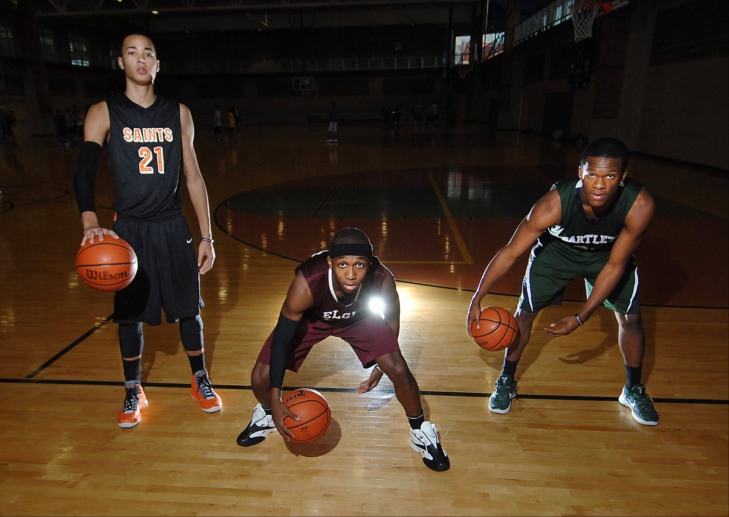 Kendall Stephens of St. Charles East High School, Arie Williams of Elgin High School, and Lance Whitaker of Bartlett High School, are AAU teammates.