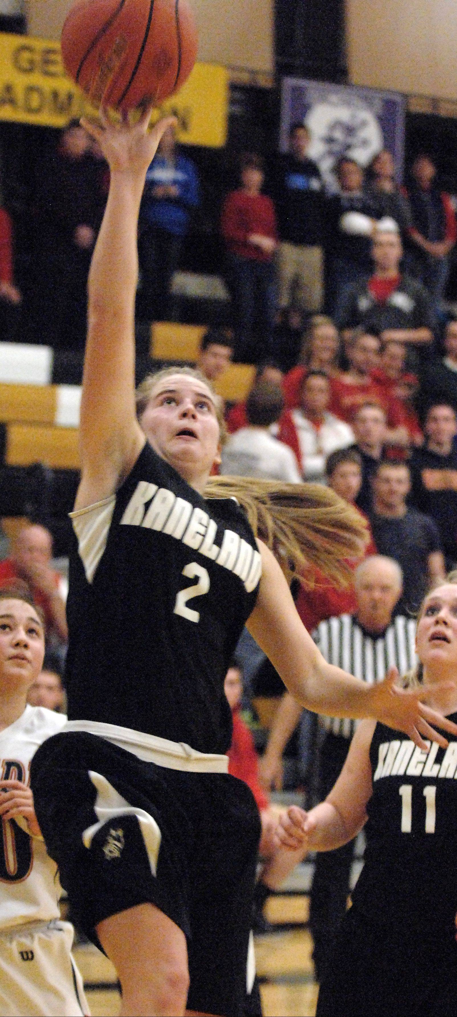 Kaneland's Sarah Grams, pictured going in for a layup in last year's sectional championship game against Belvidere North, is one of the seniors who has helped turn the Knights' record around the past few years.