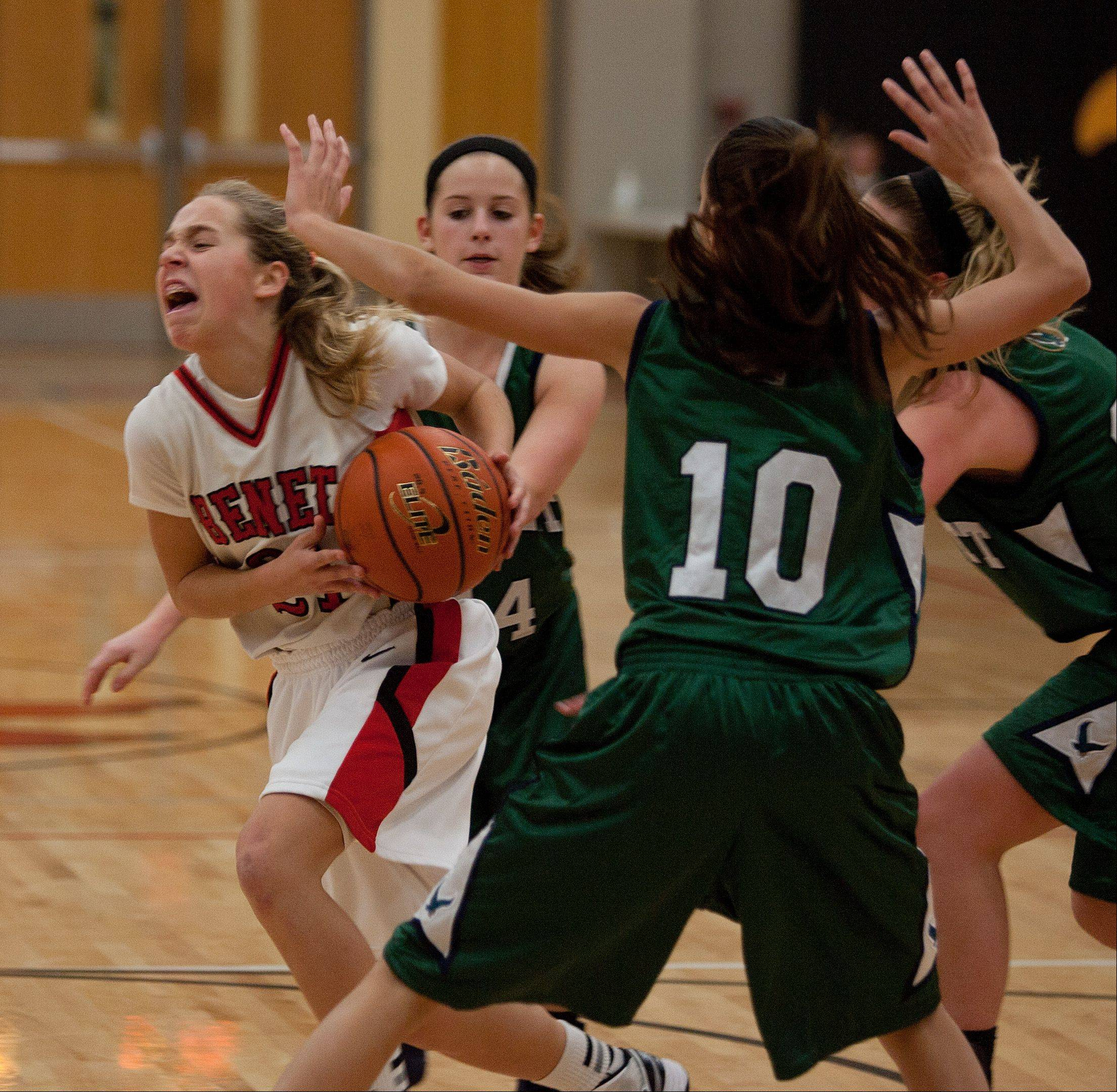Benet's Kathleen Doyle, left, drives past Bartlett's Nicole Gerdevich, during girls basketball action at Benet.