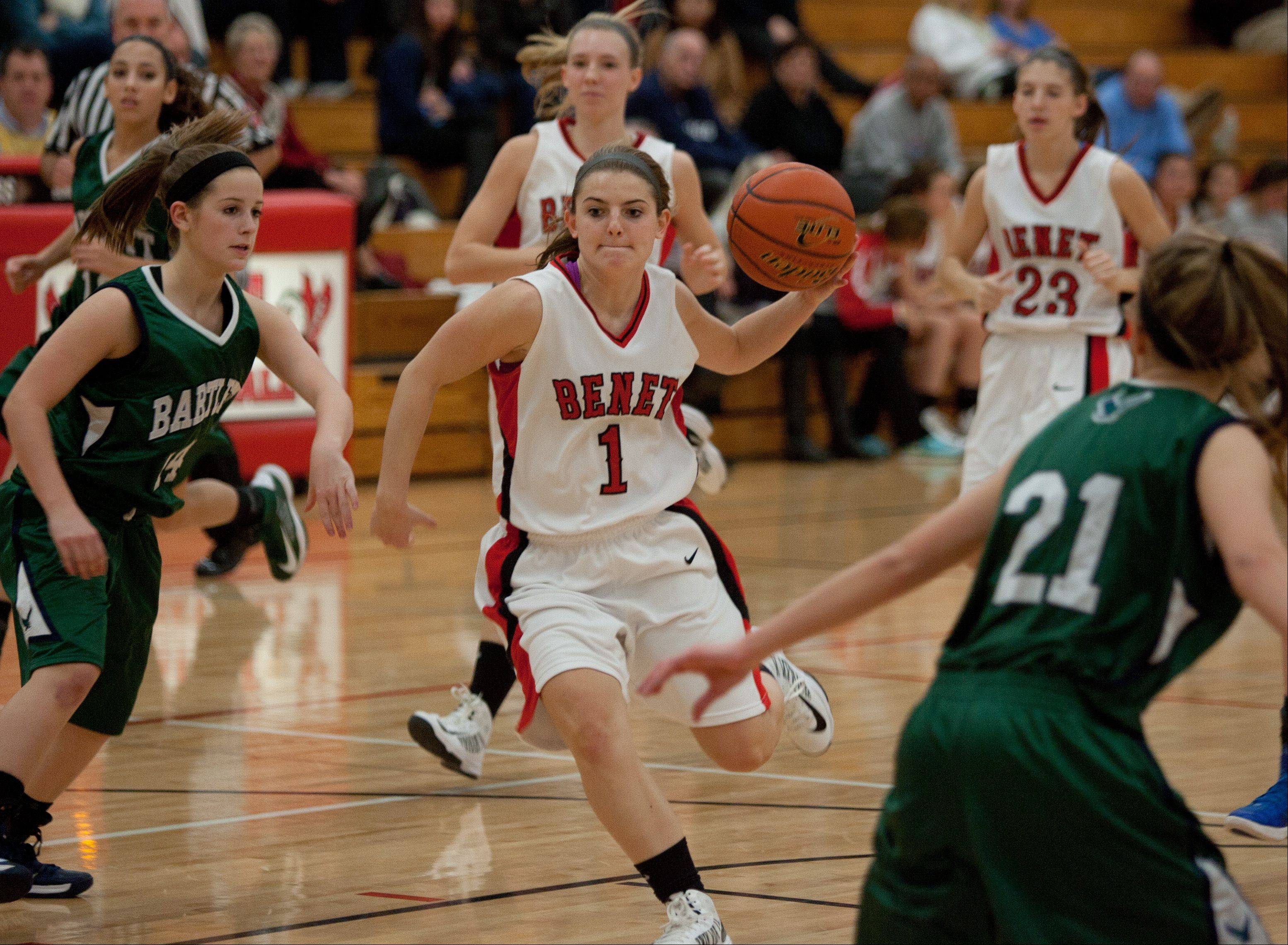 Benet's Morgan Thomalla (1) drives the lane against Bartlett, during girls basketball action at Benet,