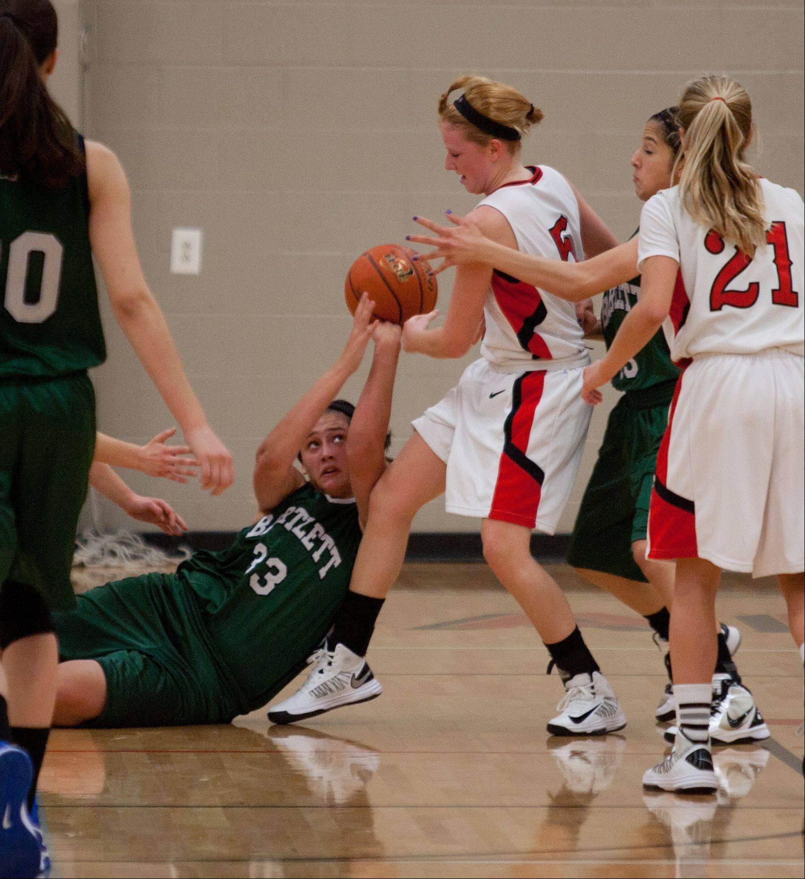 Bartlett's Alyssa Hernandez (33) battles Benet's Jenna Martin (5), during girls basketball action at Benet,