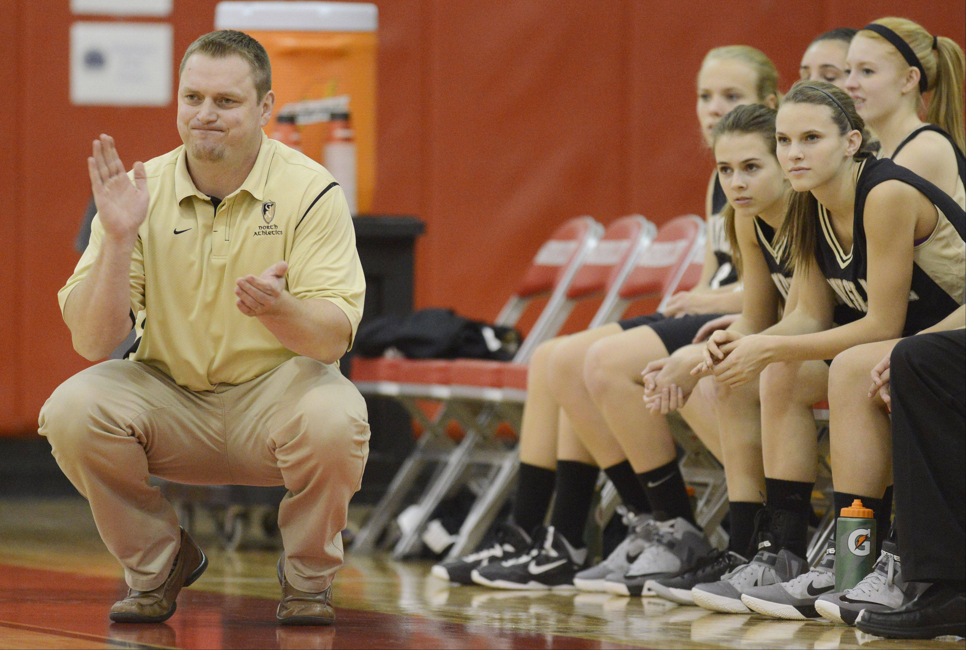 Grayslake North coach Nate Flannery leads his team during Friday's game against Prairie Ridge.