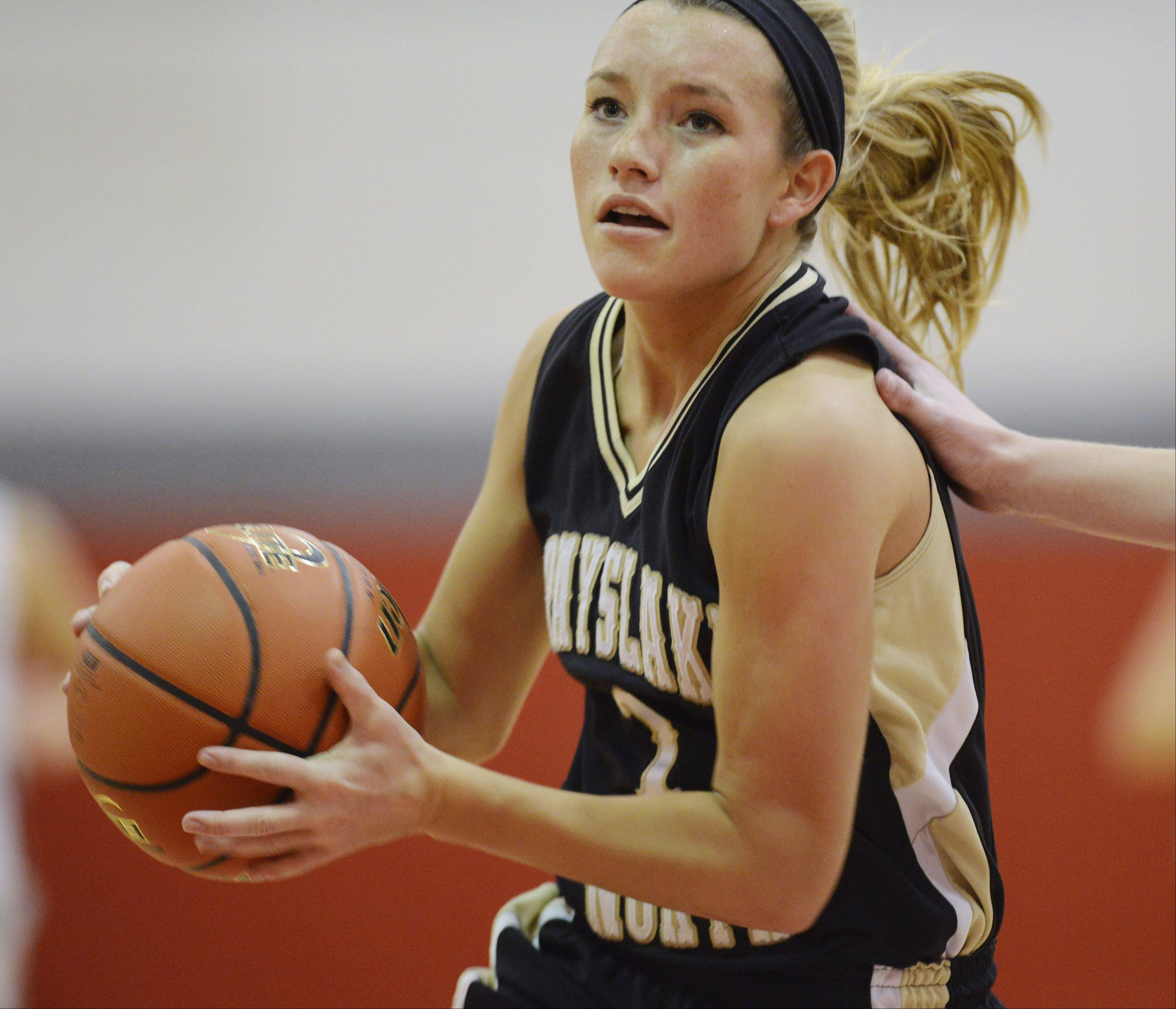 Jordyn Bowen of Grayslake North drives to the basket despite contact from a defender during Friday's game at Mundelein.