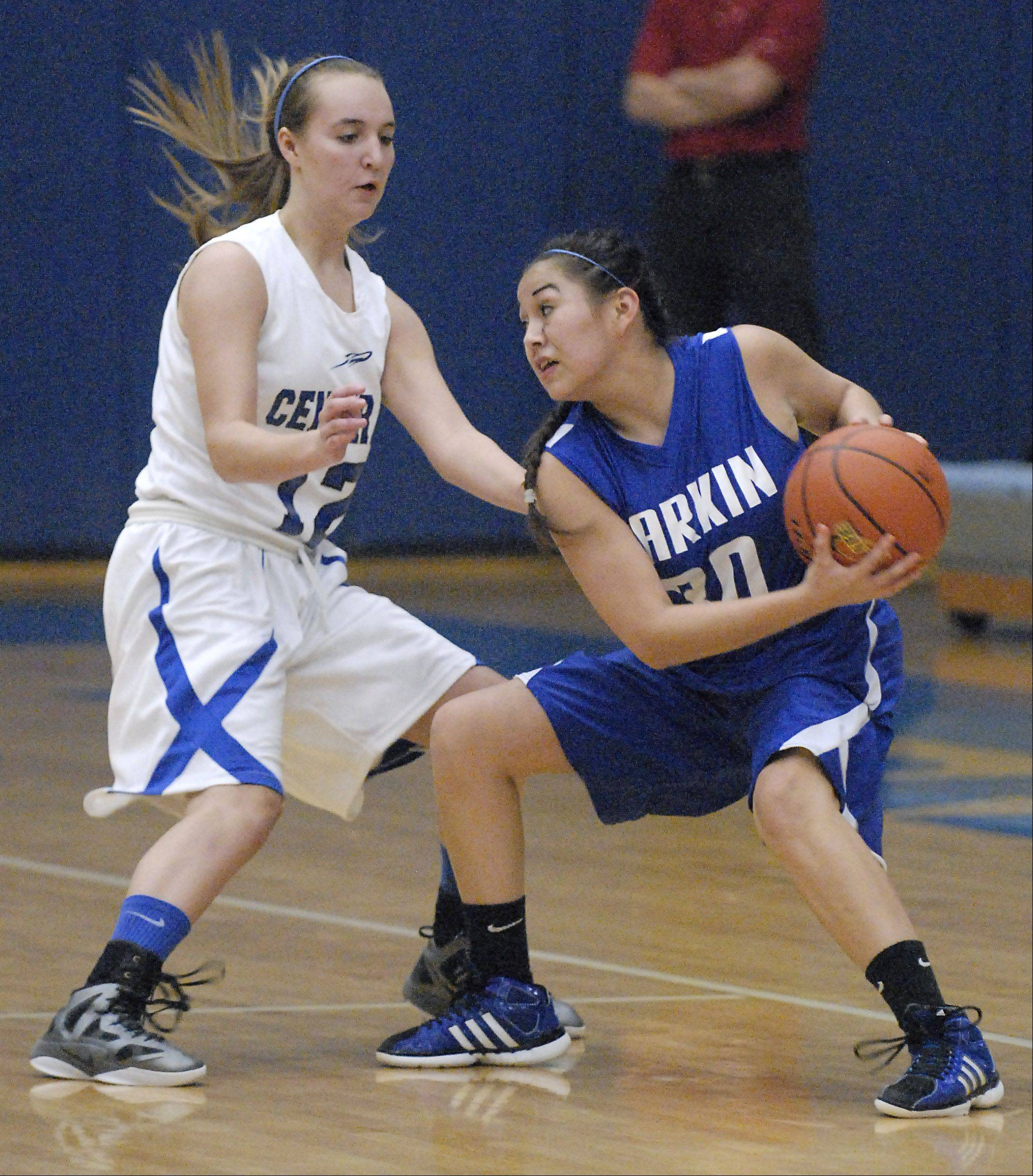 Larkin's Sky Evans looks to pass around Burlington Central's Shelby Holt in the first quarter on Friday.