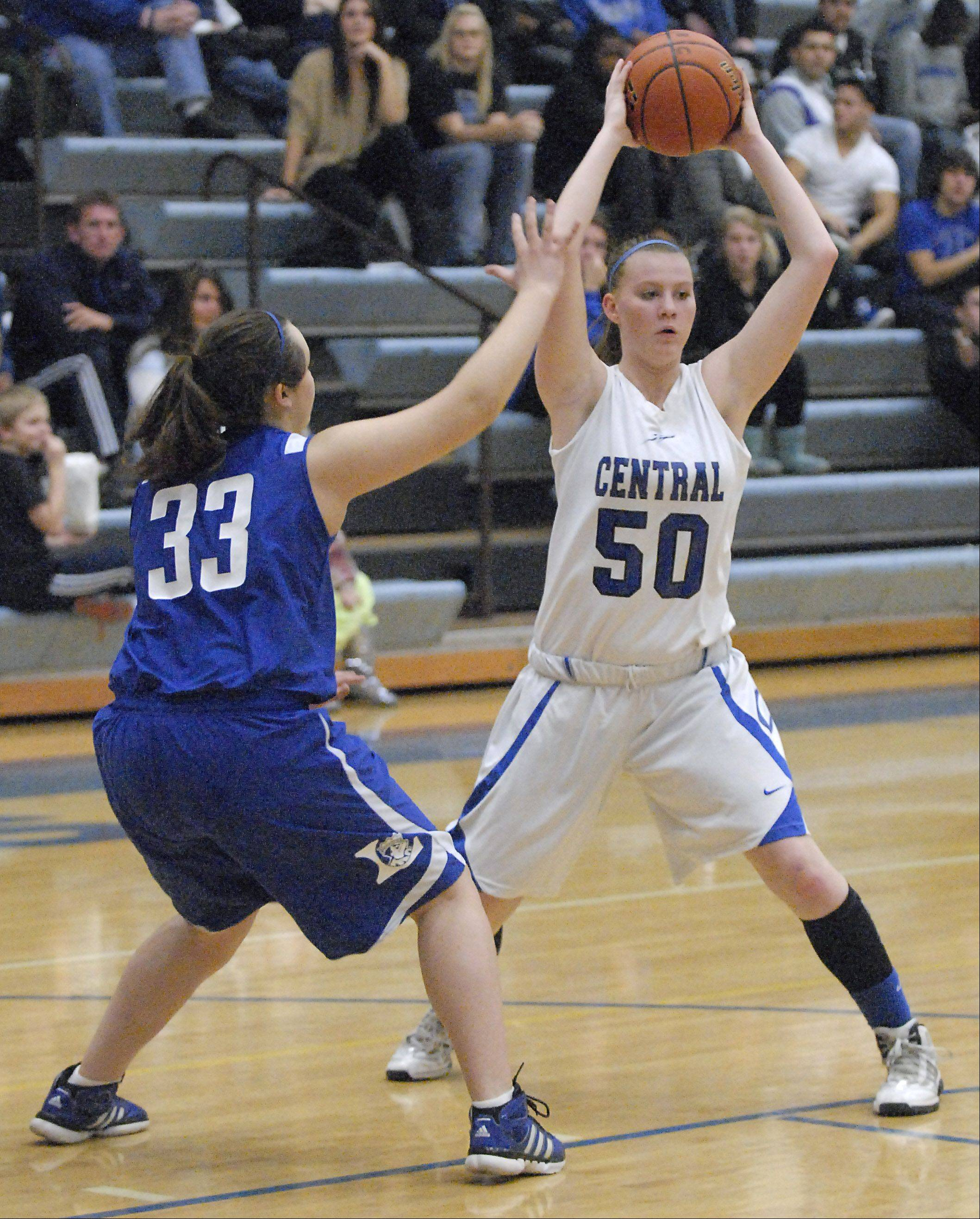 Larkin's Rachel Martinez attempts to block Burlington Central's Rebecca Gerke in the second quarter on Friday, November 16.