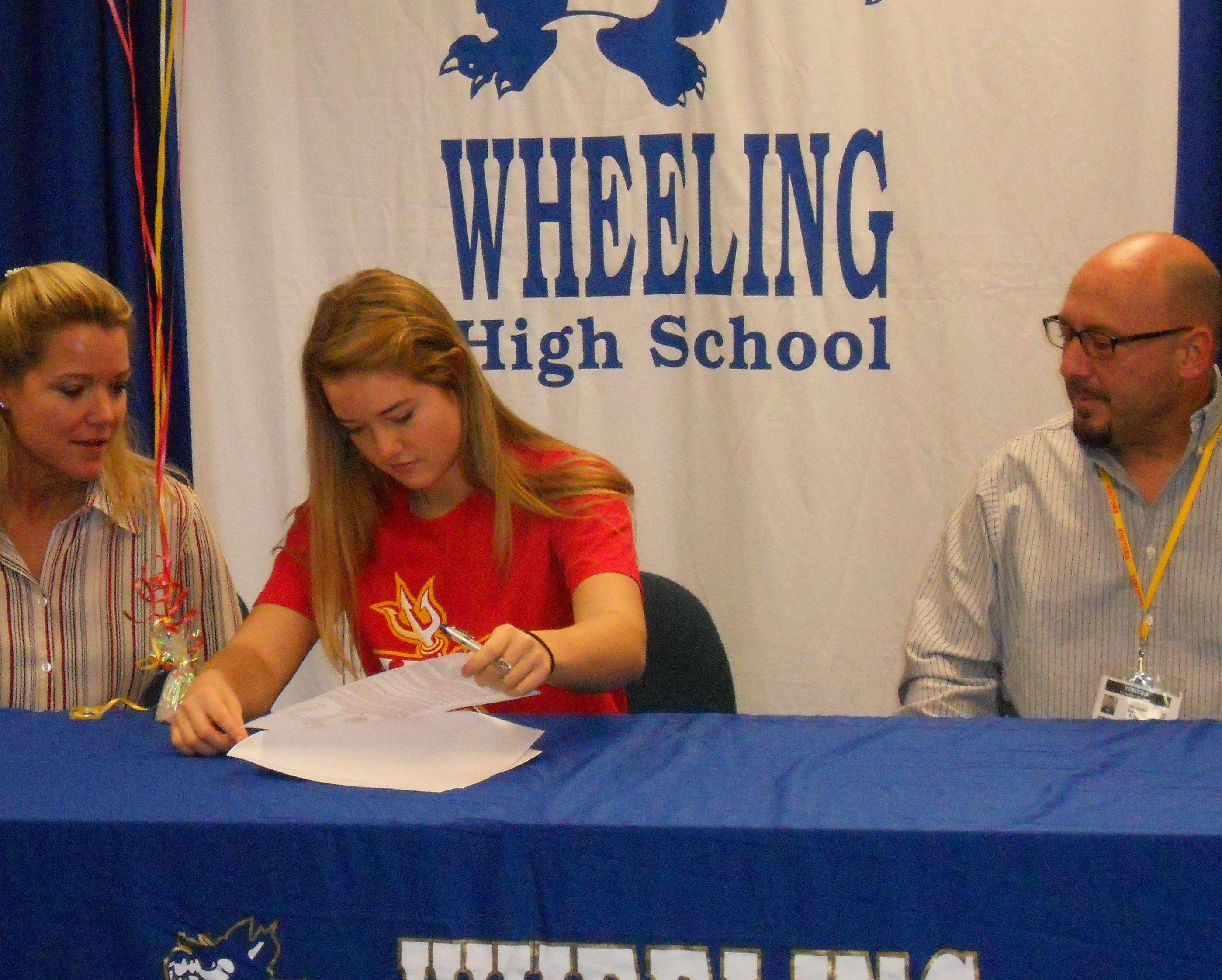Wheeling's Sara Kern makes her commitment to Missouri-St. Louis softball official last week.
