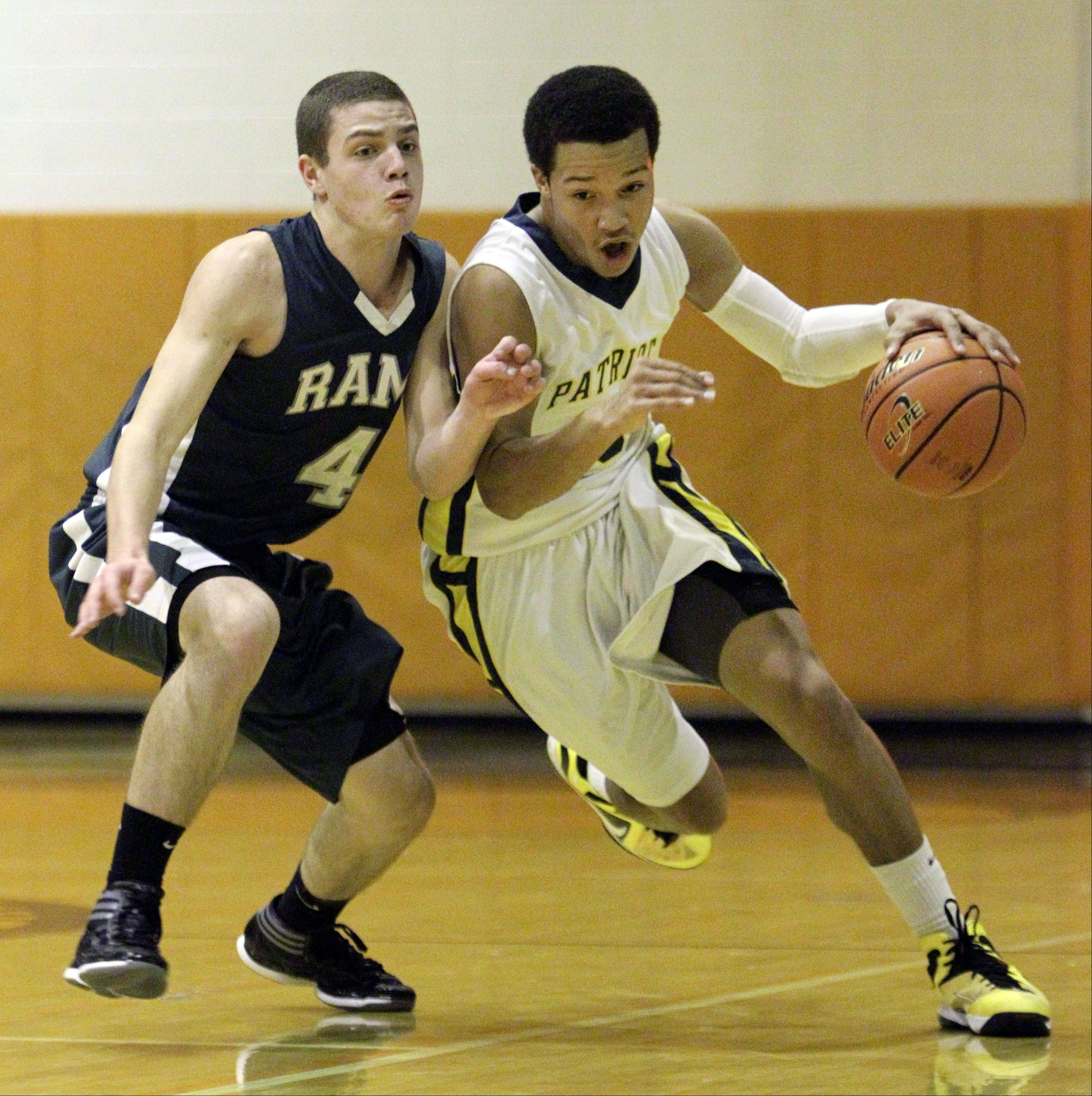Stevenson's Jalen Brunson, right, drives on Grayslake Central's Jacob Vargo at the Bison Classic Thanksgiving Tournament held at Buffalo Grove on Monday.