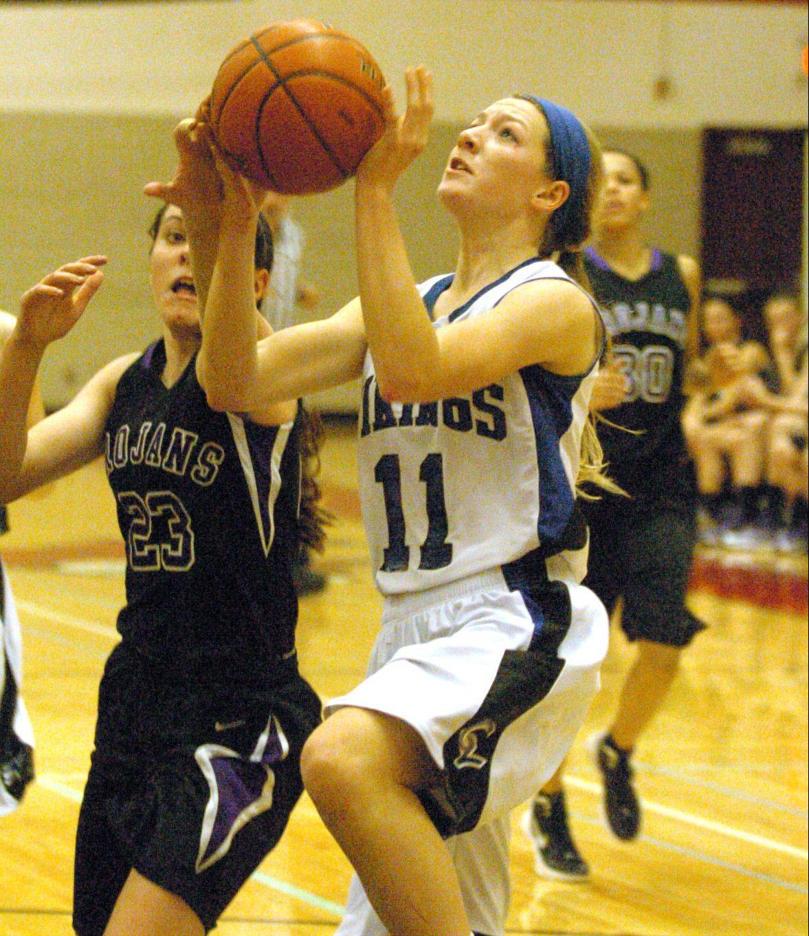 Geneva's Michaela Loebel goes in for a layup.