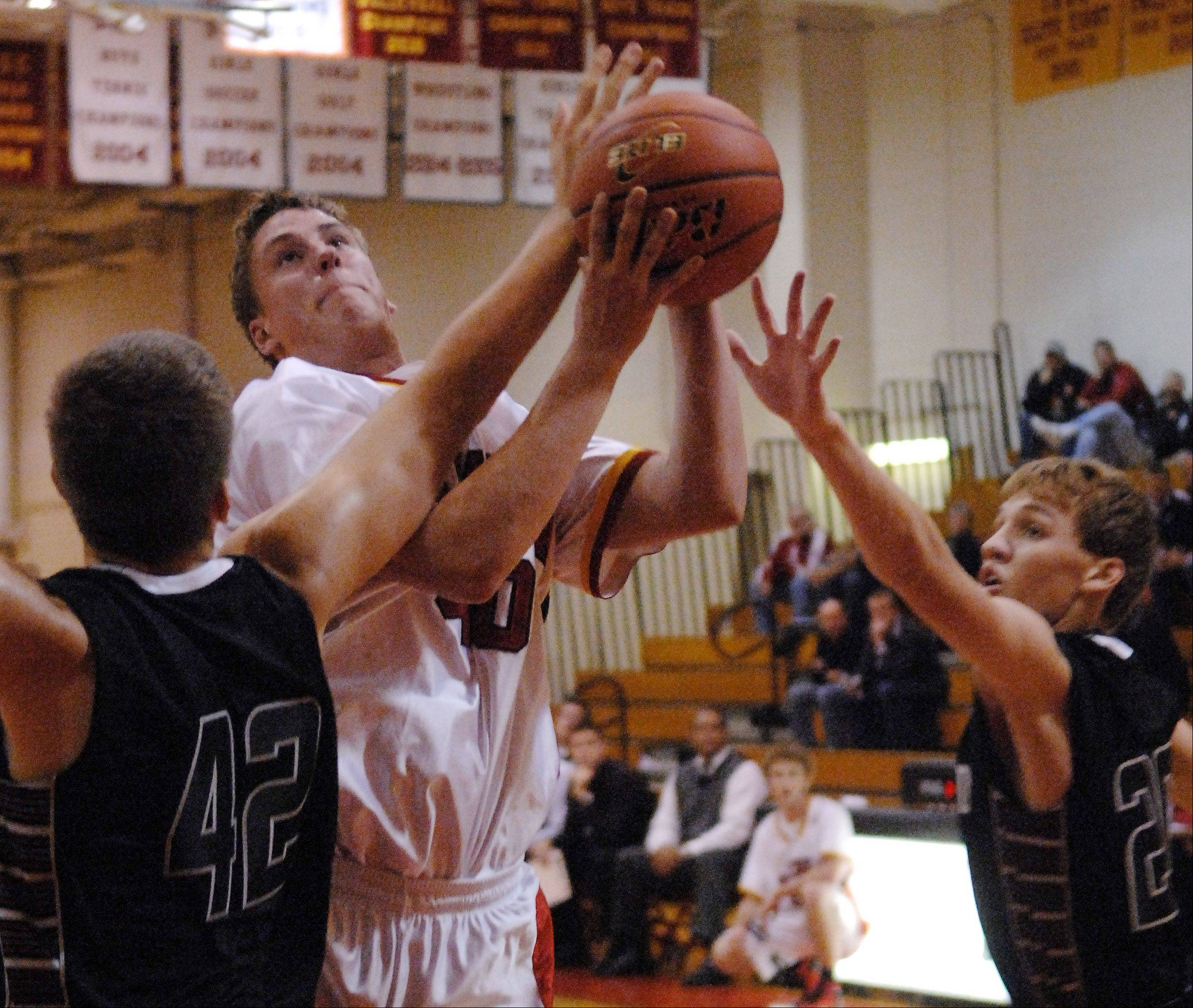 Batavia's Mike Carlson tries to get to the basket against Kaneland during Wednesday's game at Batavia.