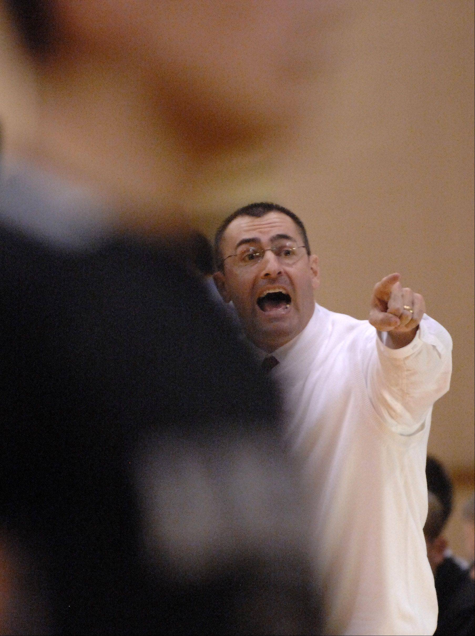 Jim Nazos yells out to his players as he coaches his first game for Batavia against Kaneland Wednesday at Batavia.