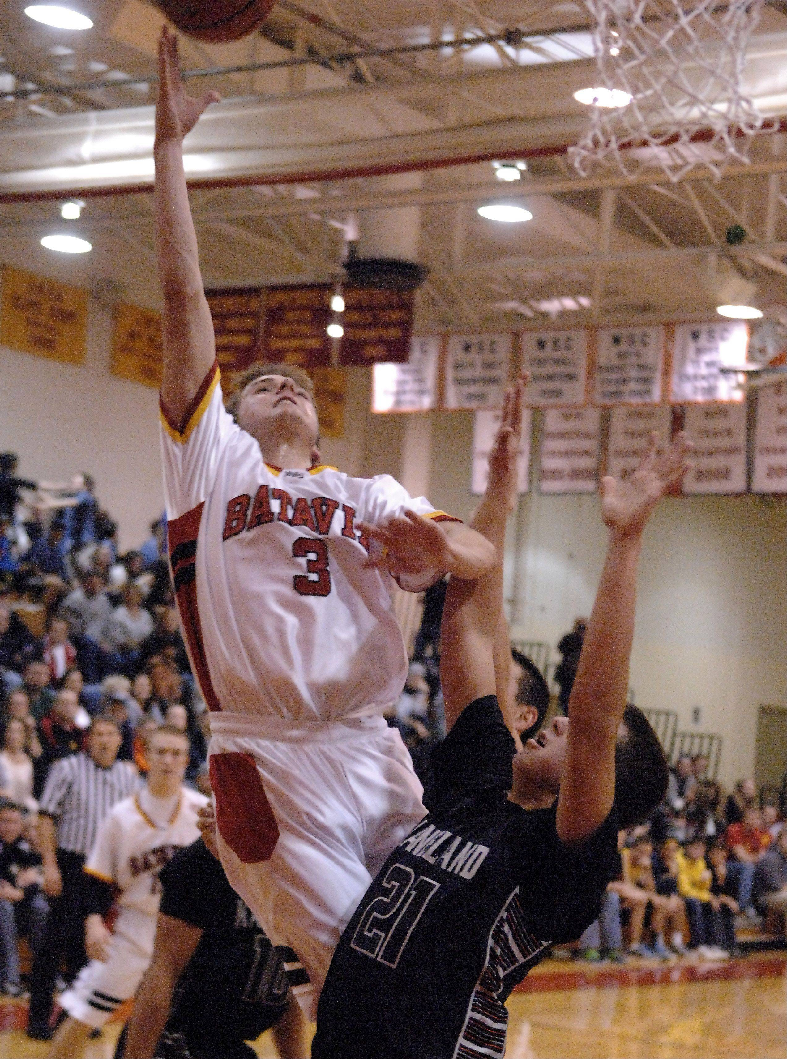 Batavia's Jake Pollack drives to the basket and is fouled against Kaneland during Wednesday's game at Batavia.