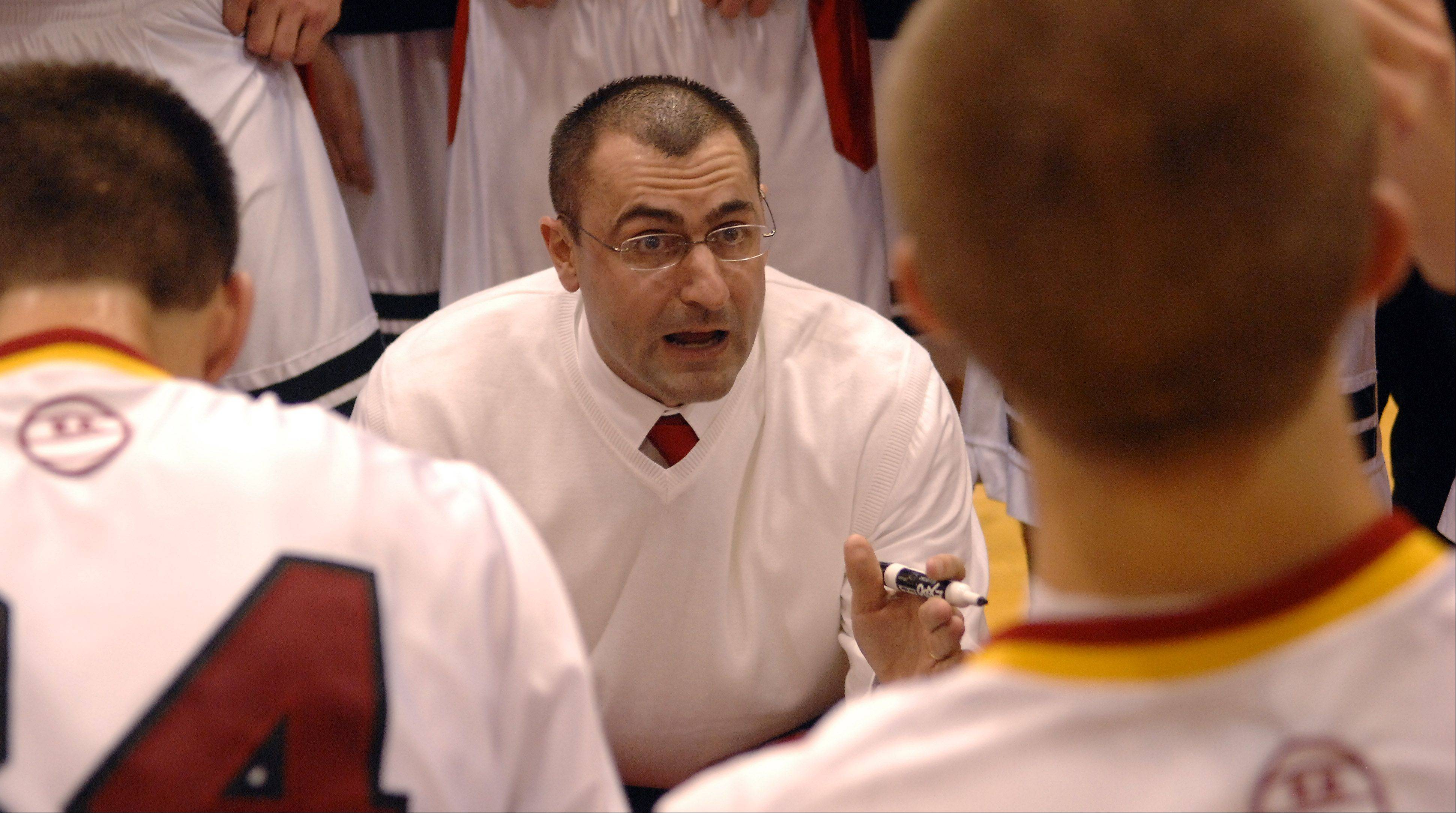 Batavia head coach Jim Nazos talks to his players between periods against Kaneland during Wednesday's game at Batavia.