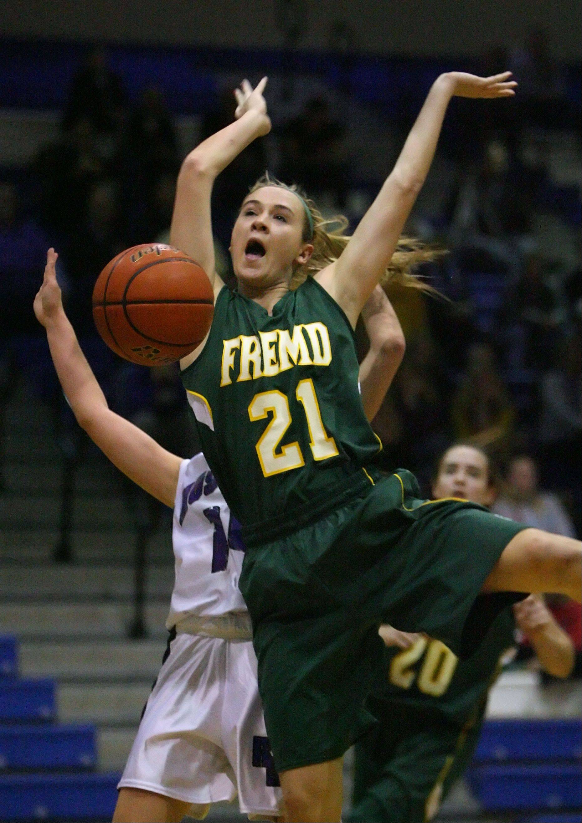 Fremd's Ashley McConnell gets the ball stripped by Rolling Meadows' Sami Kay as she drives to the hoop Wednesday night at Lake Zurich.