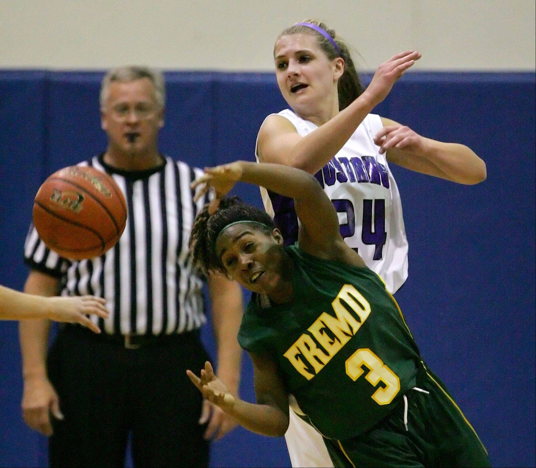 Rolling Meadows' Alexis Glasgow, right, and Fremd's Brianna Lewis battle for a loose ball Wednesday night at Lake Zurich.