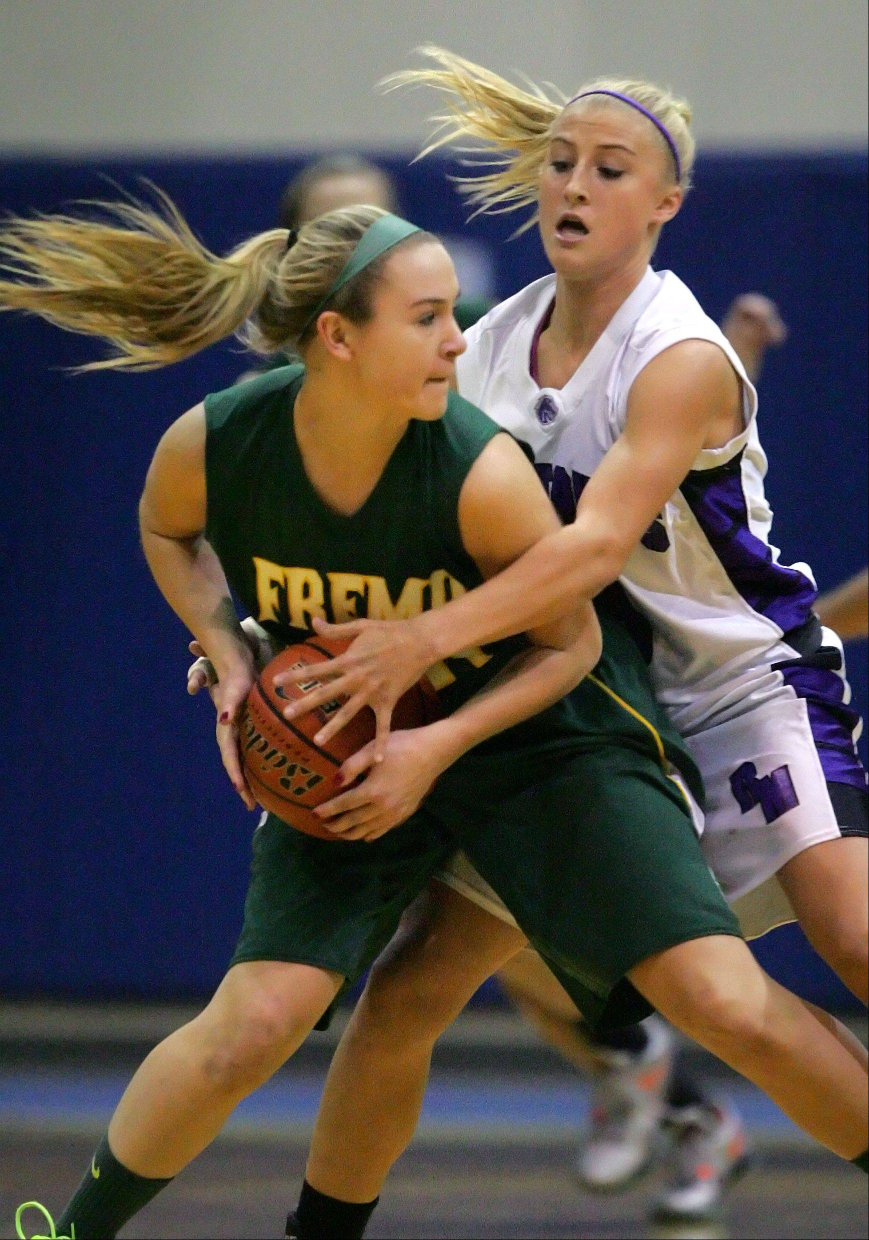 Rolling Meadows' Jackie Kemph, right, plays some tough defense on Fremd's Ashley McConnell Wednesday night at Lake Zurich.